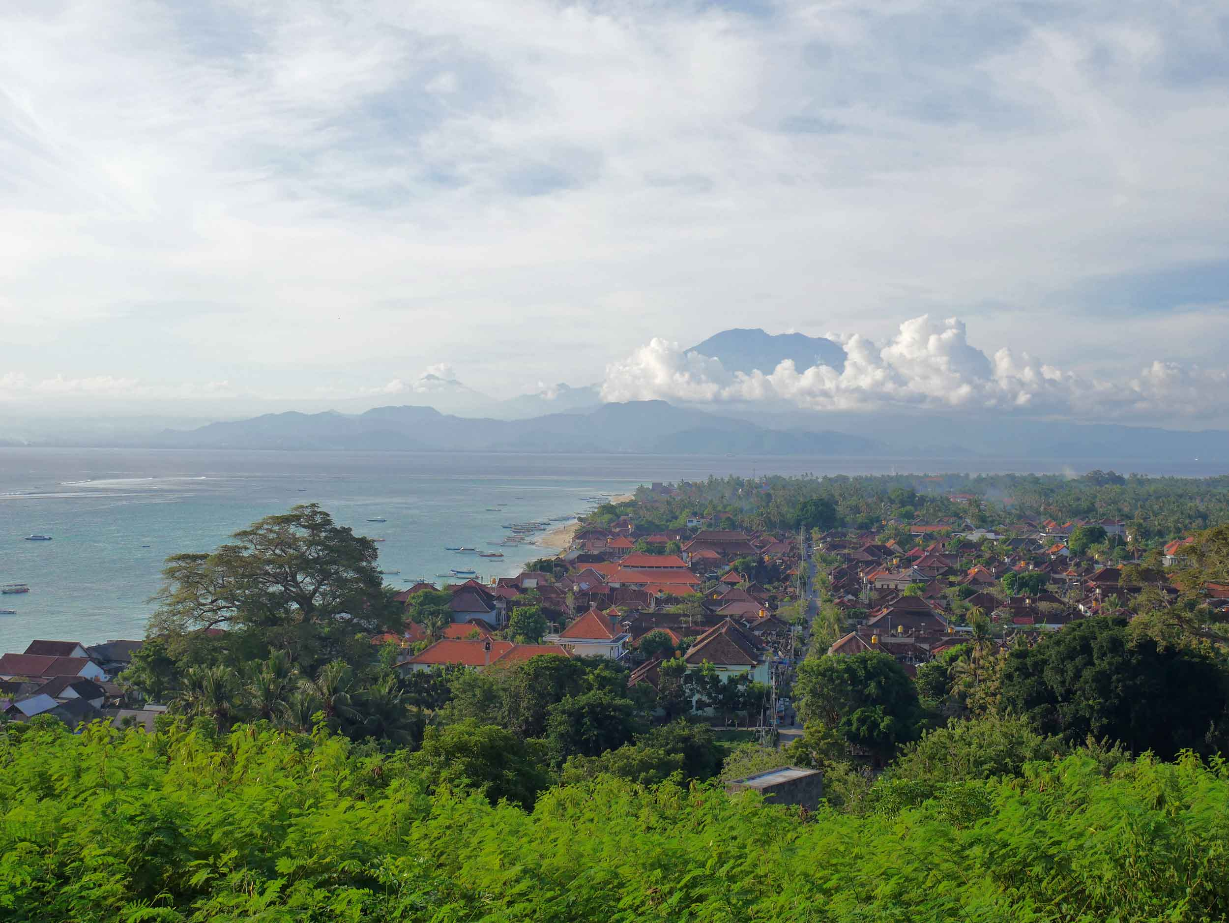 The view of Lembongan's port town with Bali's Mount Agung rising above the clouds in the background (May 16).