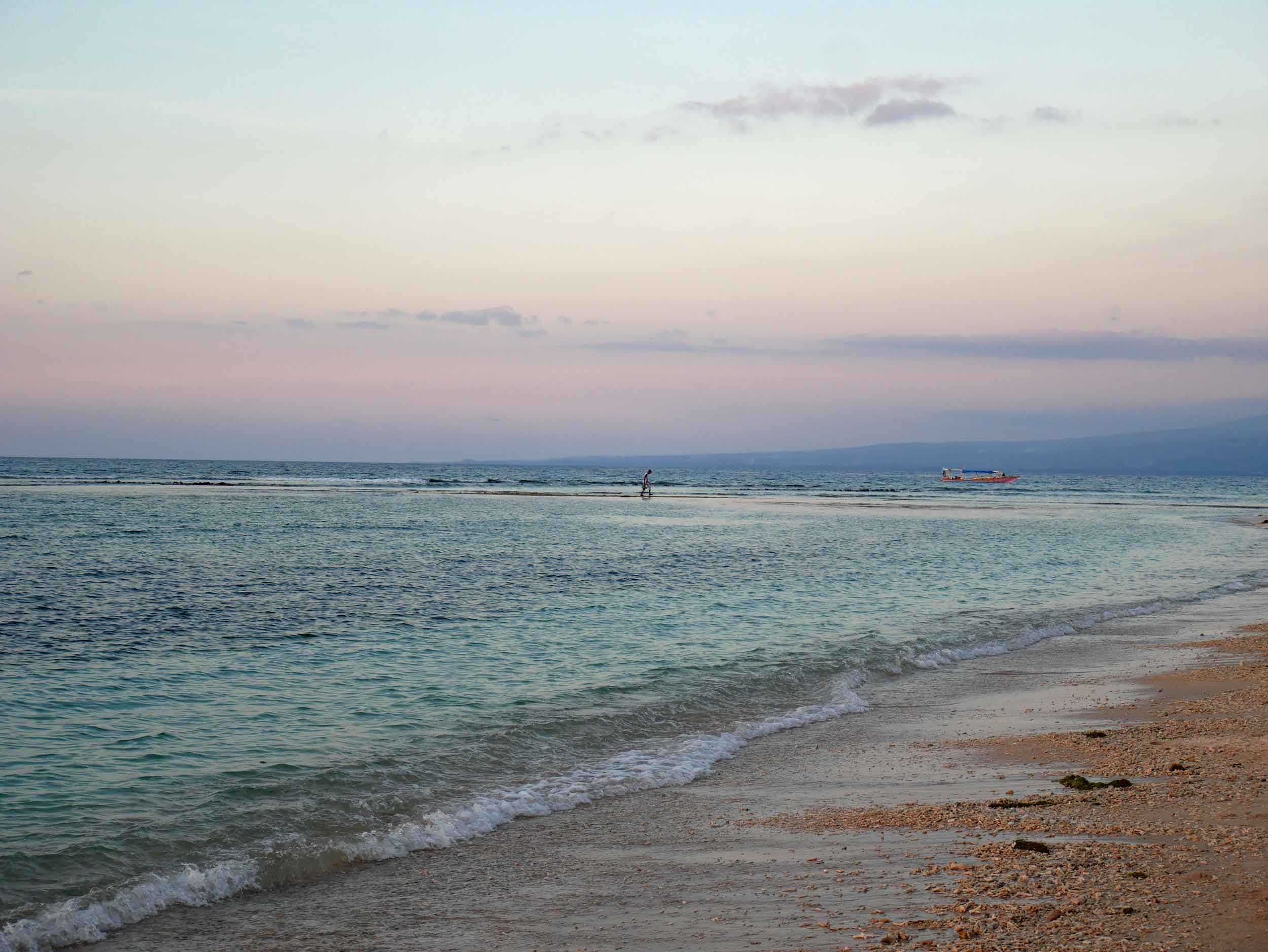 Sunset from the Gili Air coast, where a fisherman was taking advantage of the low tide to seemingly walk on water.