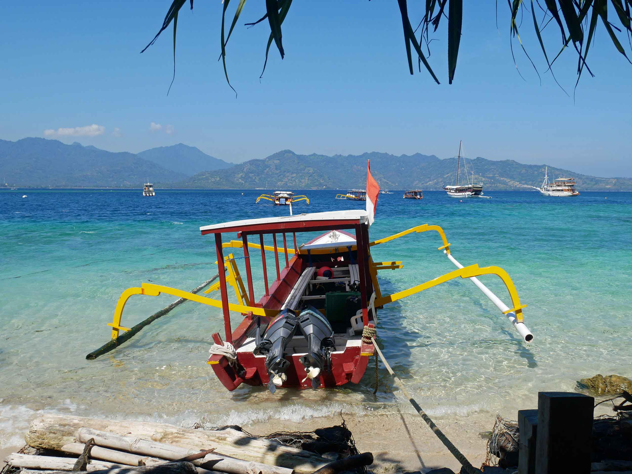 We loved the unique shapes and bold colors of these traditional Indonesian fishing boats.