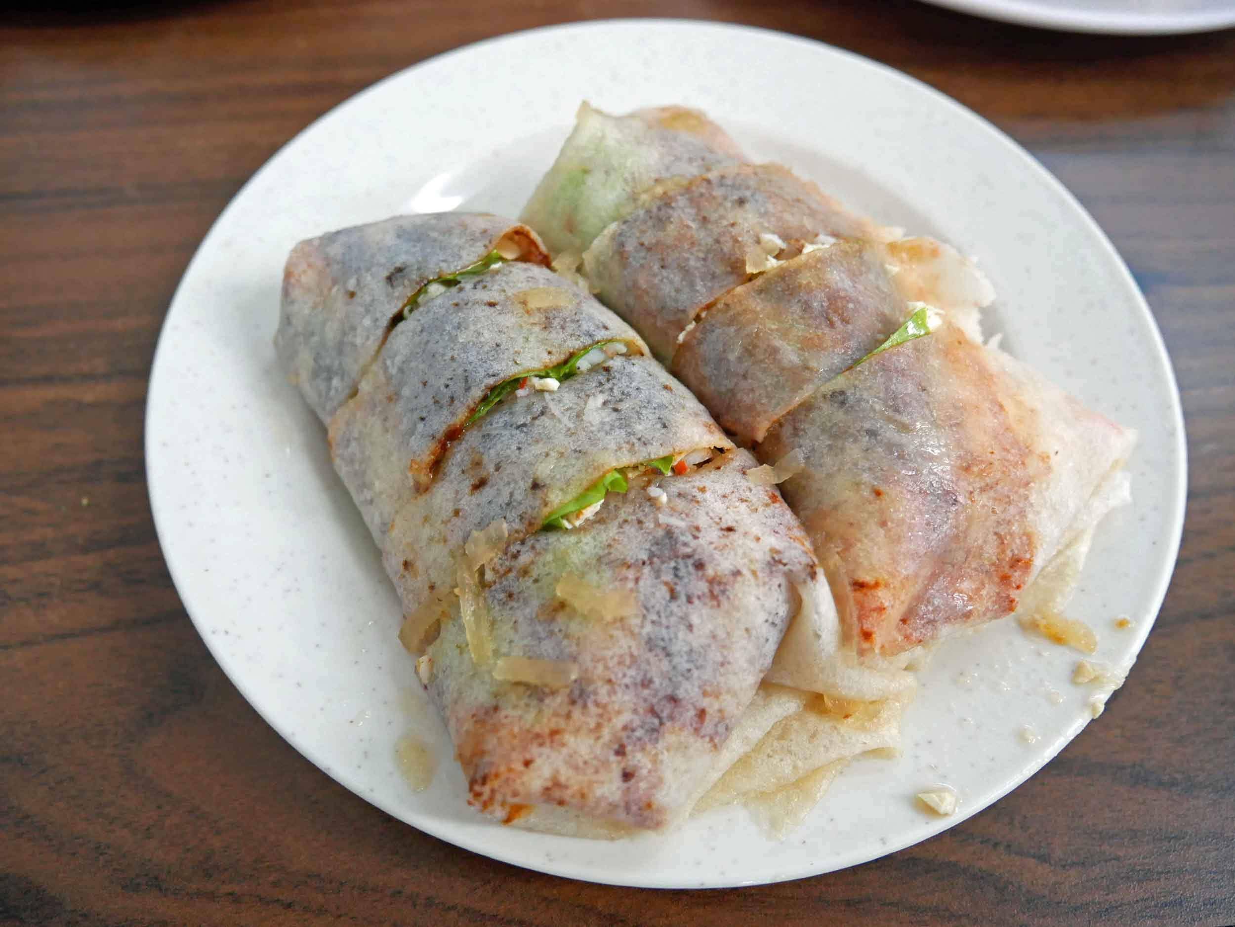 One of the local specialties was  seafood popiah , a thin crepe roll with a mix of crab, omelette and fried shallots inside.