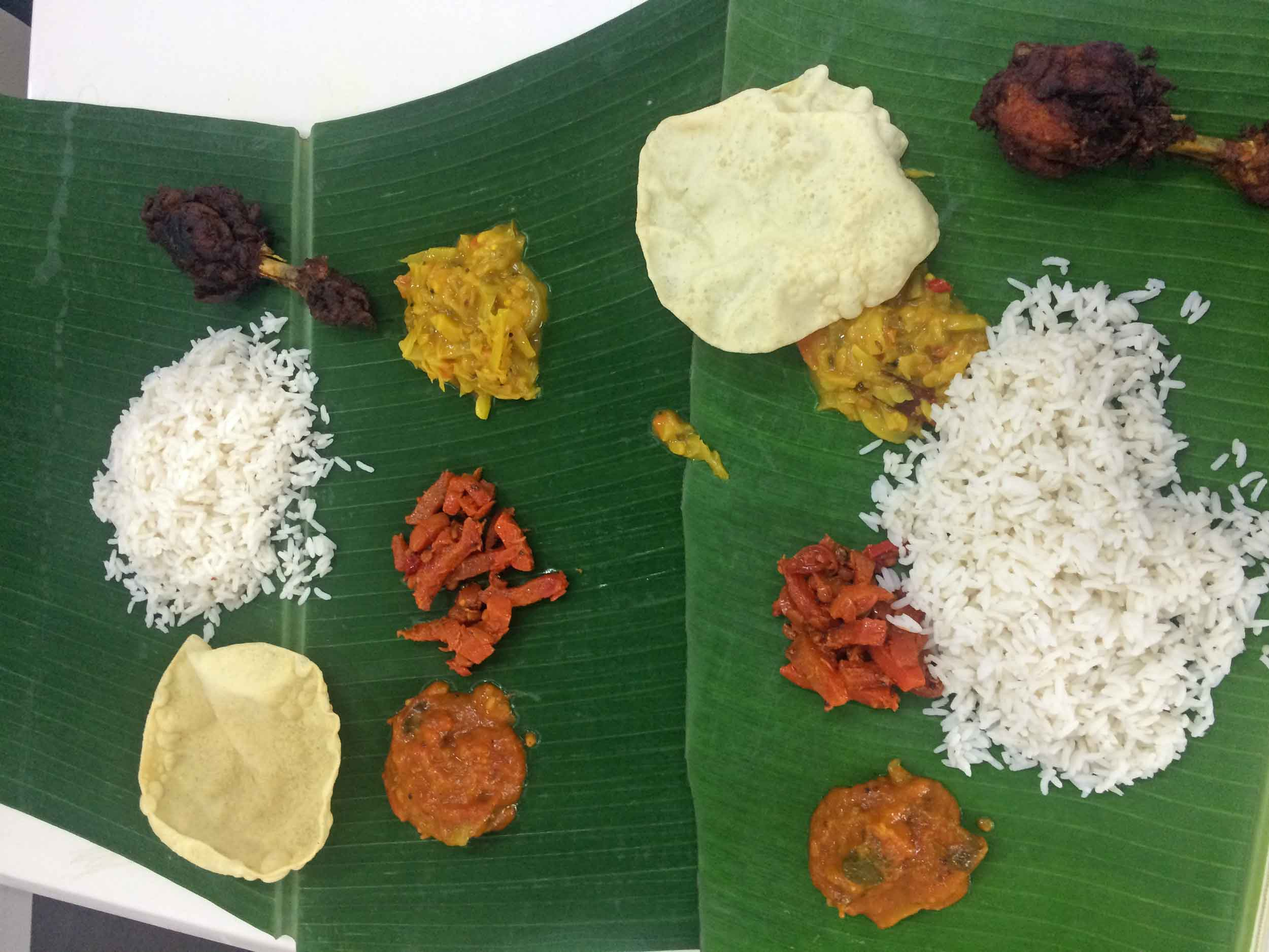 We chose a restaurant known for its  banana leaf rice and chicken curry .