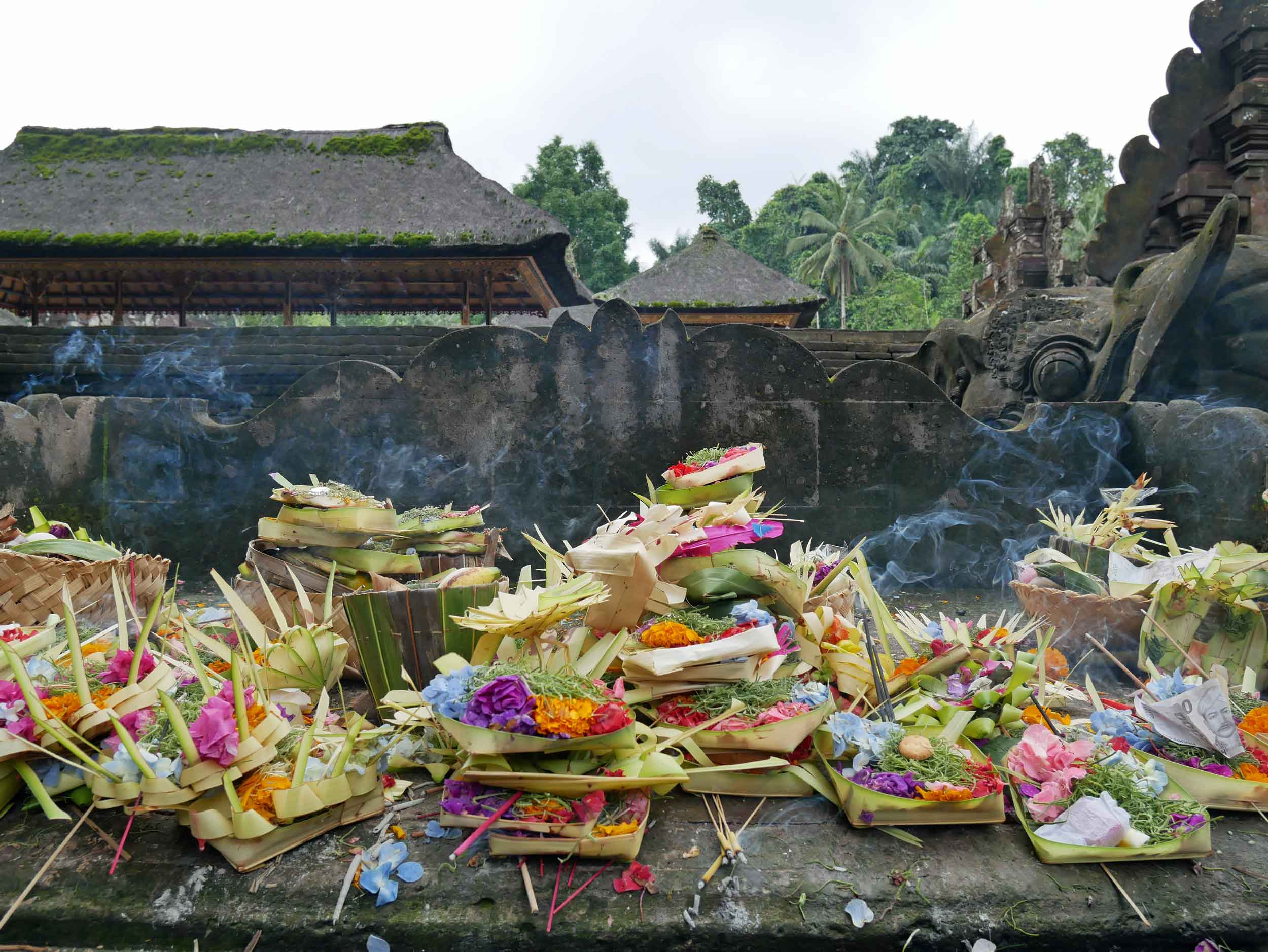 Many offerings, or  canang saris , had been left at the feet of various shrines throughout the temple.