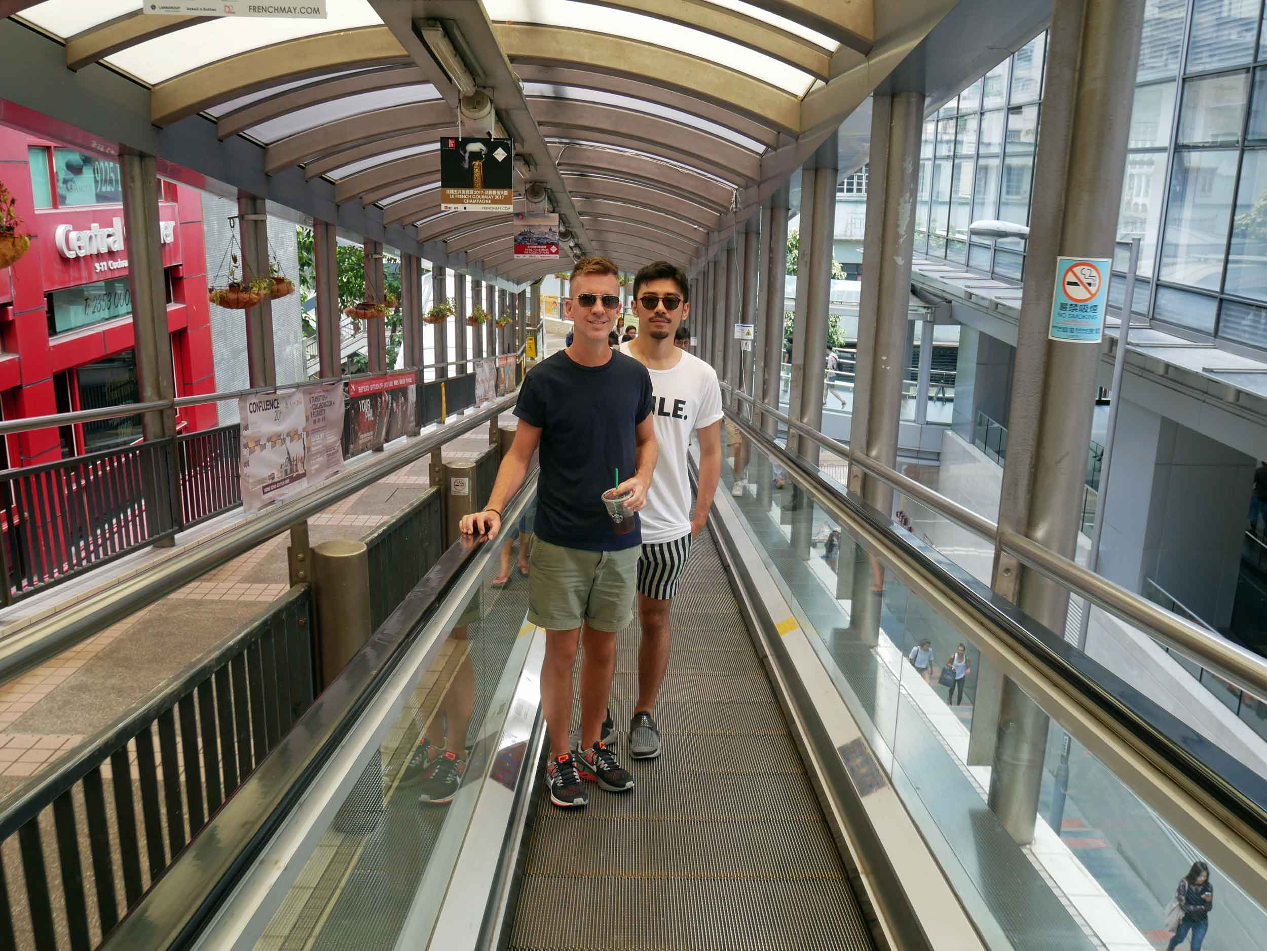 Trey and Nik ride the Central - Mid-Levels outdoor escalator, the longest moving sidewalk system in the world.