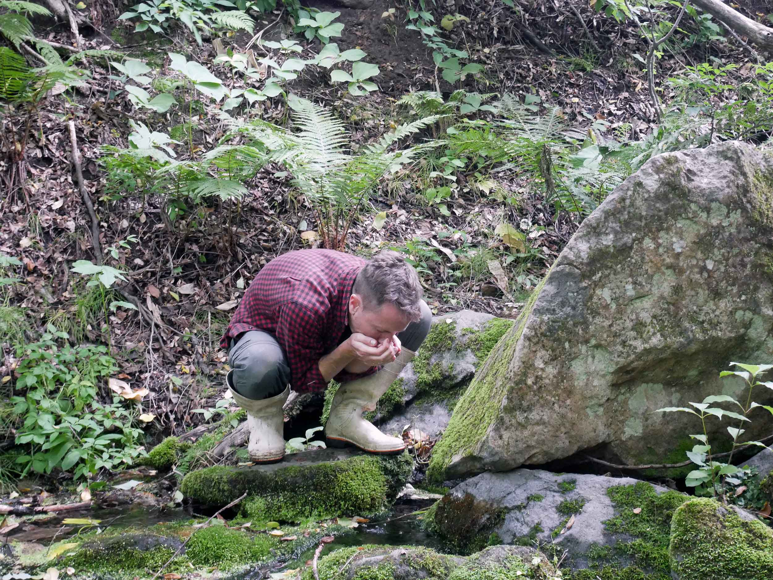 The water on the farm comes from a beautiful natural cold spring. Here, Martin has a taste straight from the source.