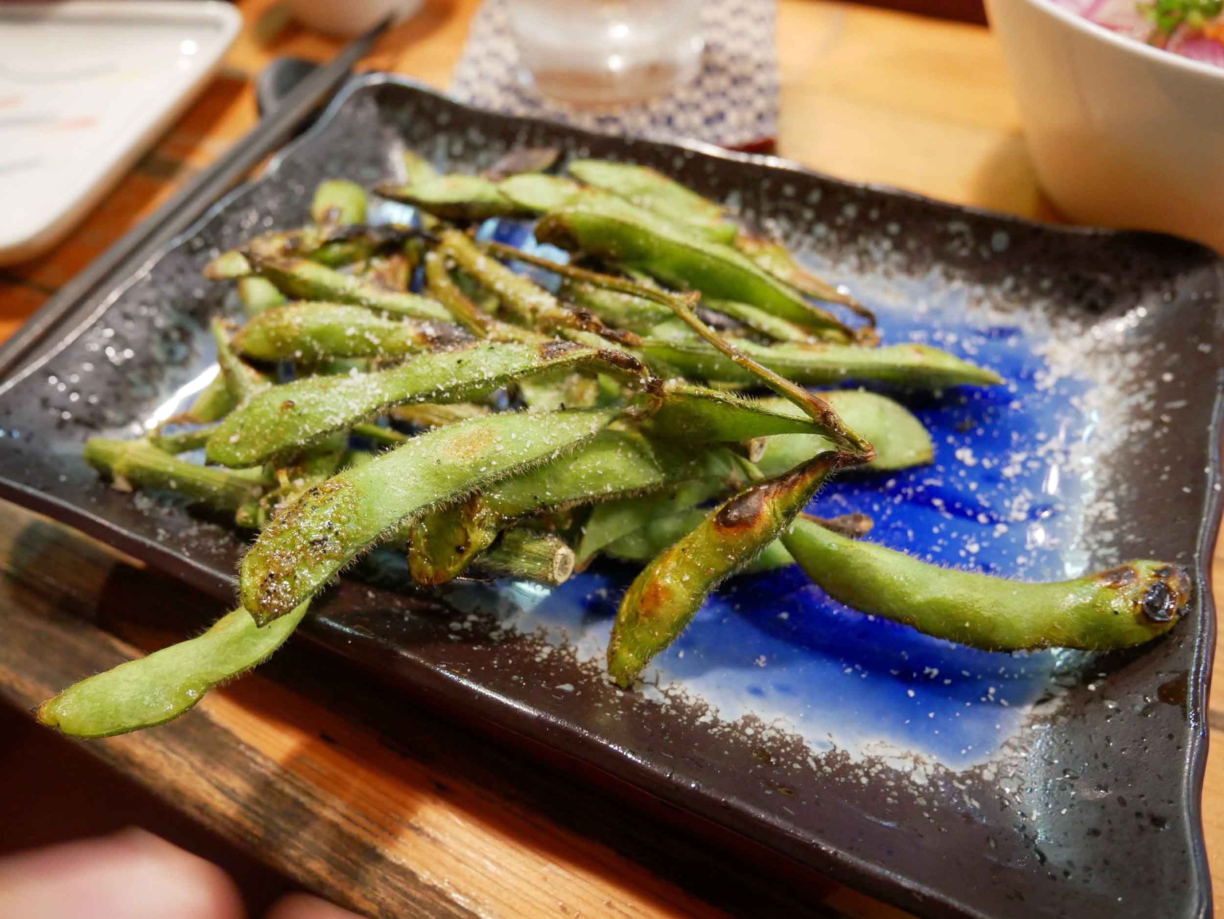Charcoal blistered edamame to start.