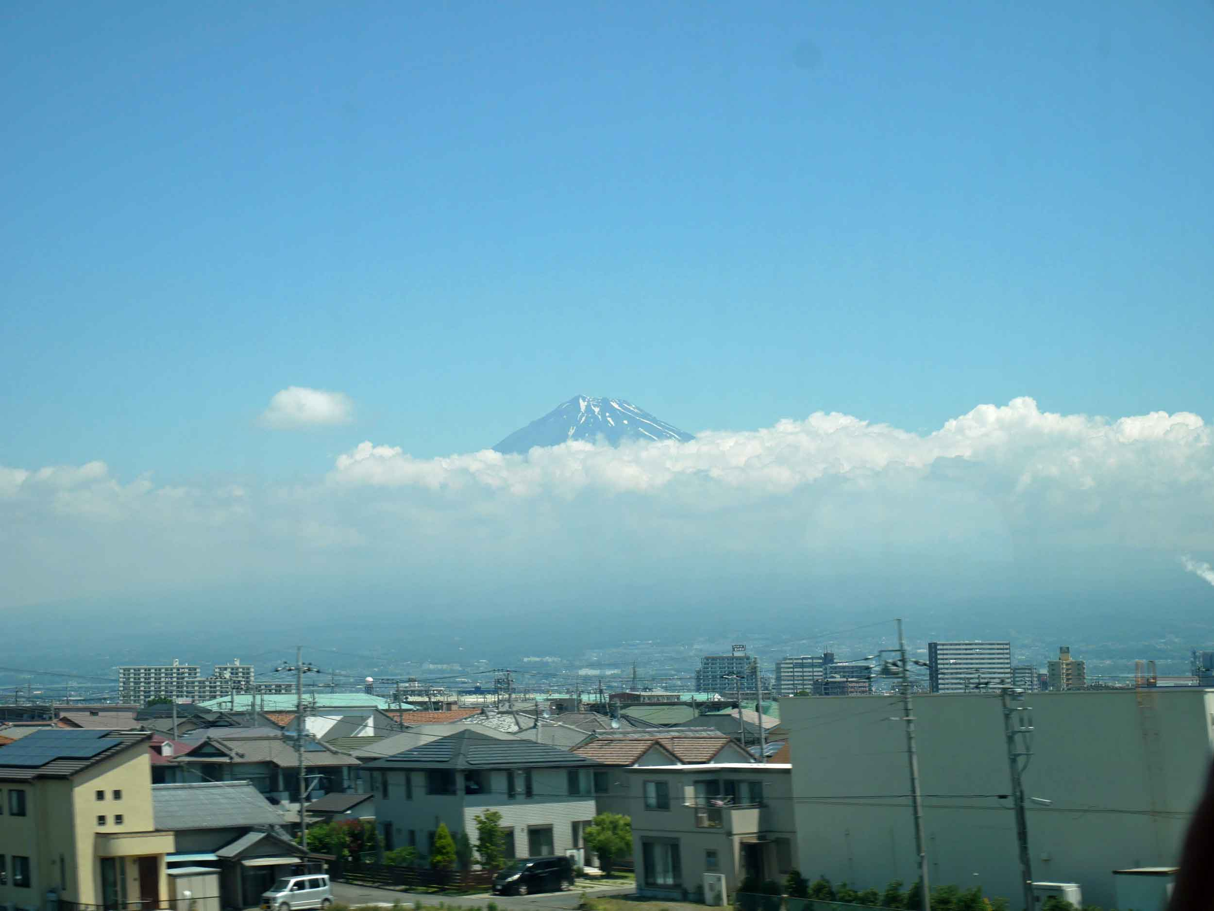Rising above the clouds, we were in awe of the magnitude of Mt. Fuji speeding by at 250 KMpH.