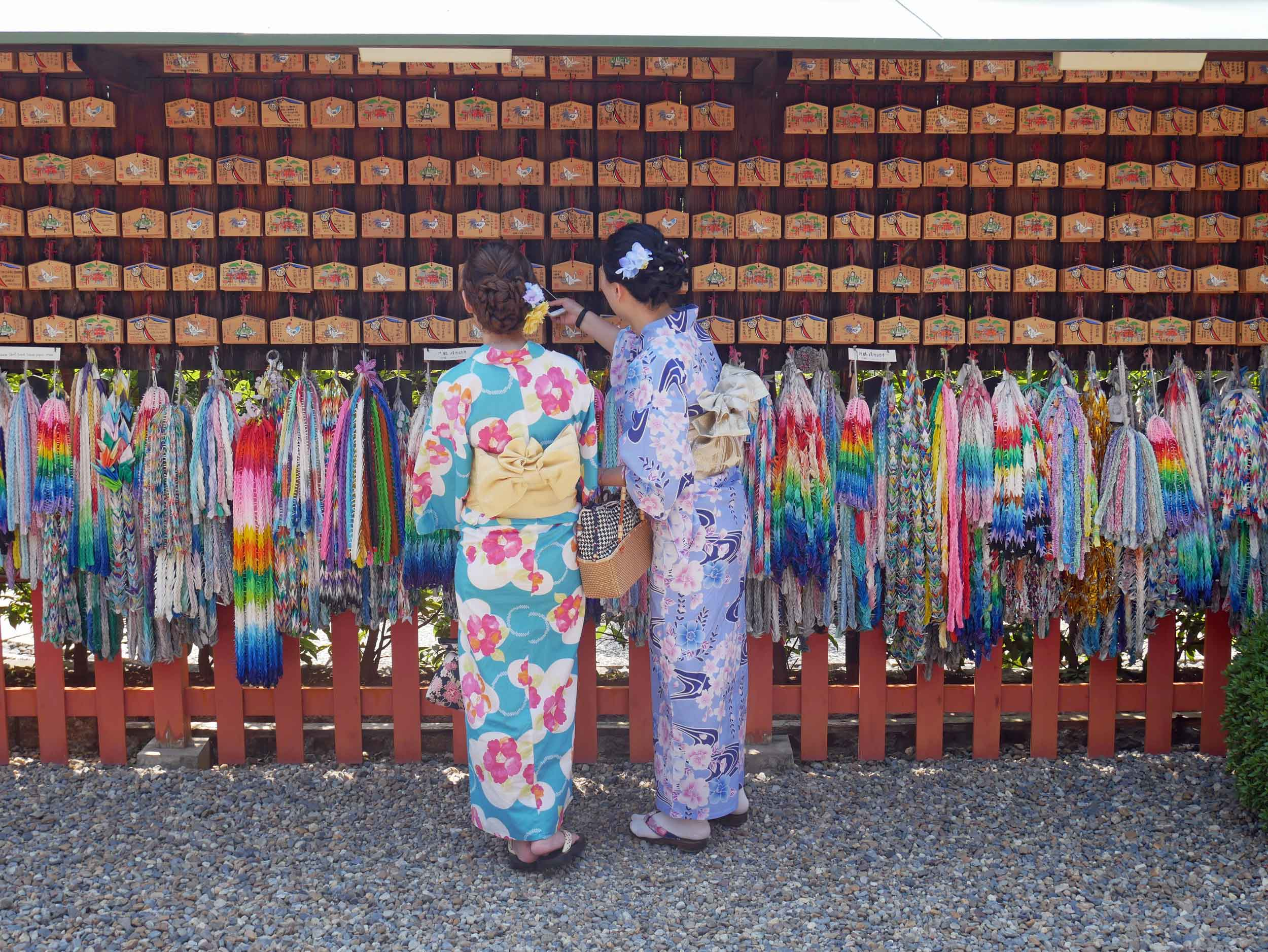 Many visitors were dressed in national costume as they took photos and made offerings around the complex.