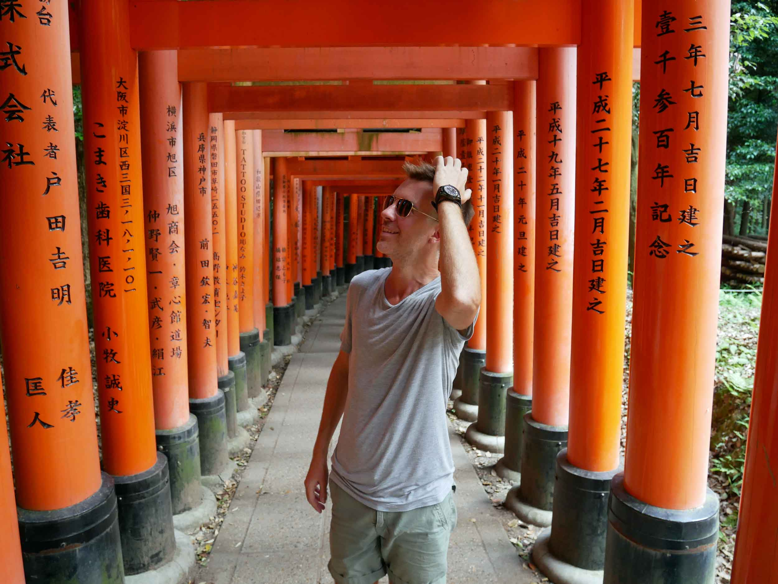 Trey tries to understand all the wishes of good fortune by the many businesses and merchants who've contributed to the Inari gates.