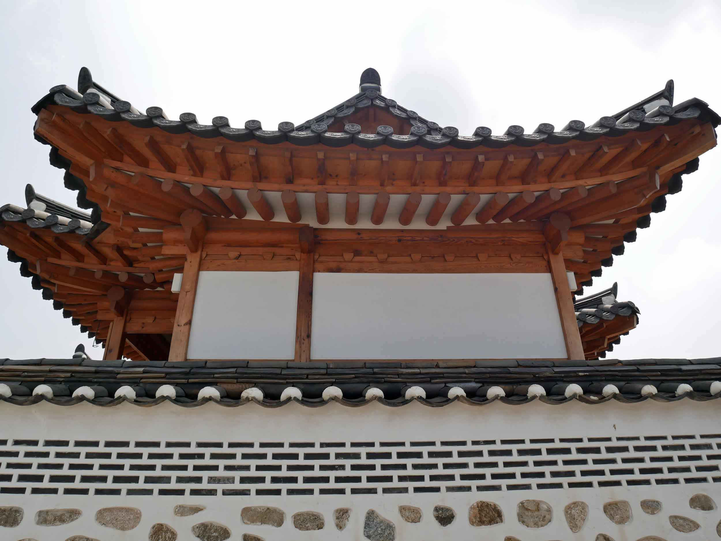 The impressive wood rooftops of the hanoks boast giant eaves to protect the homes from sun in the summer.