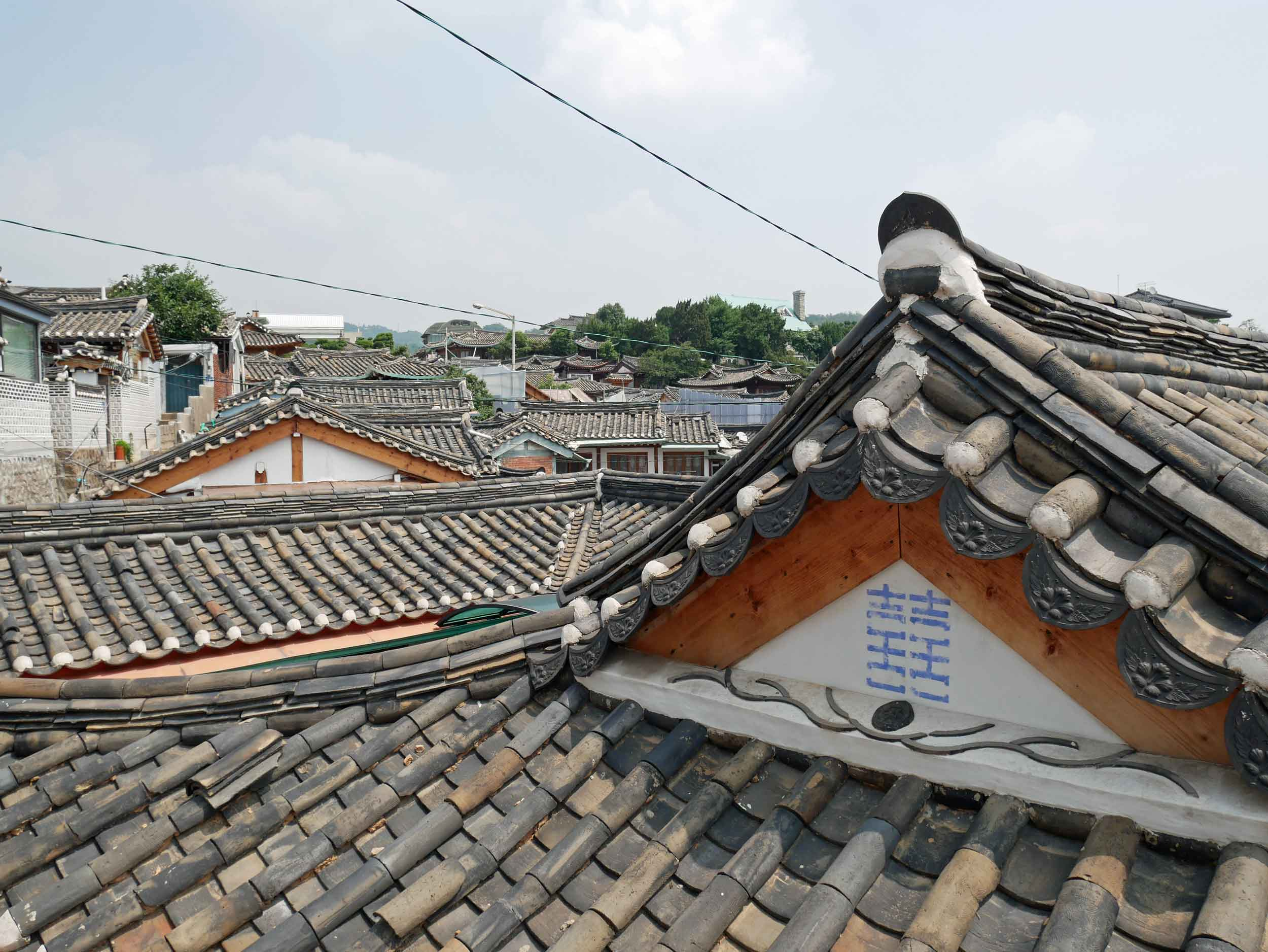 The village gently climbs the hills of Seoul offering panoramic views above the crowded roofs.