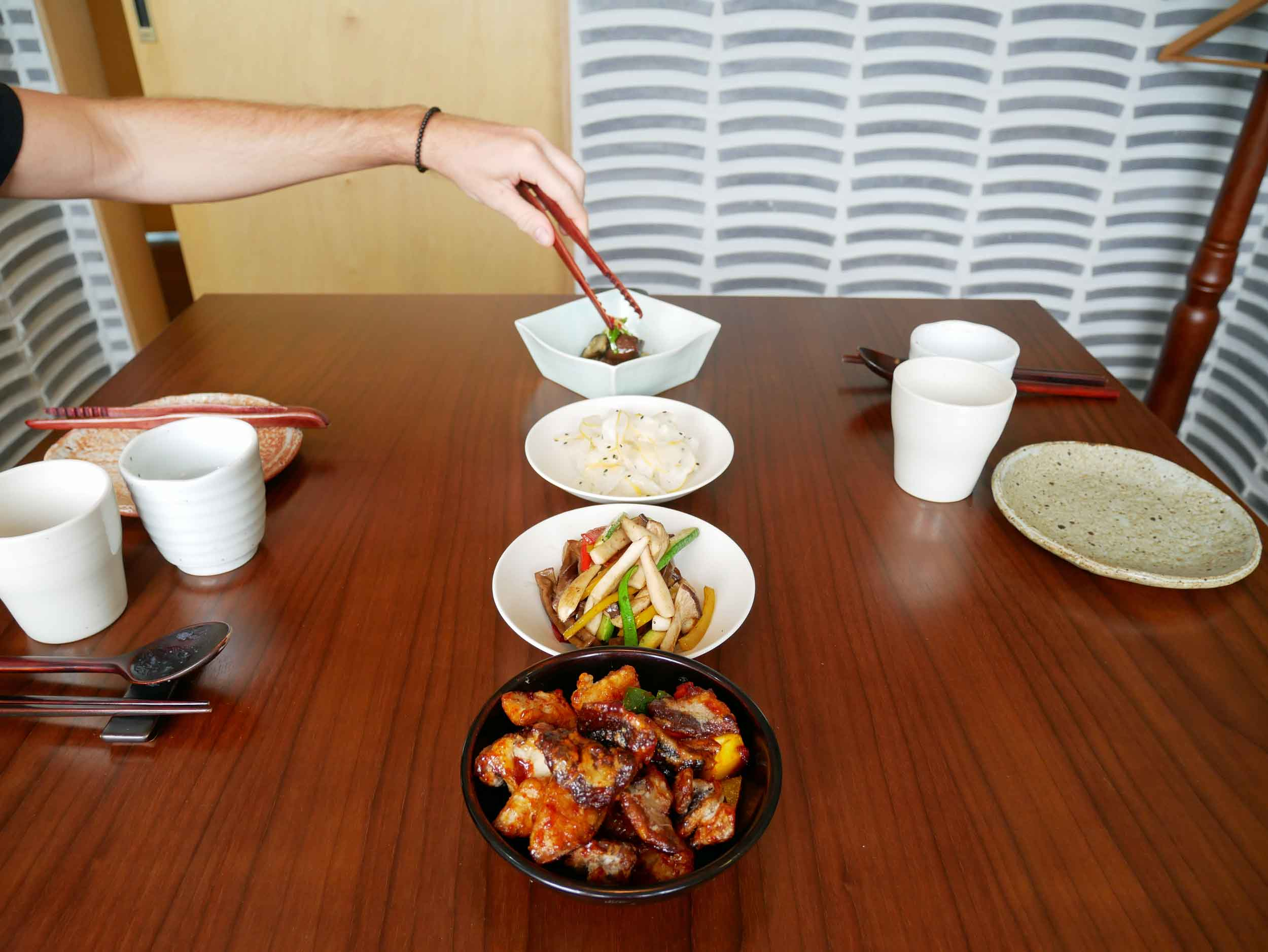 Next, we were offered  sangmi , or cold preparation, of stir-fried dried acorn jelly, seasoned Korean melon, and summer eggplant with ginger sauce.