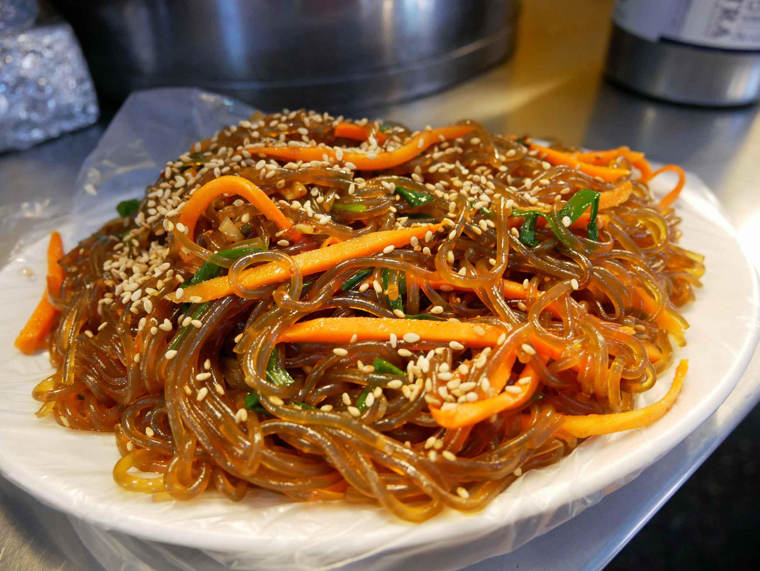 As well as slurping down  japchae , or Korean glass noodle stir fry.