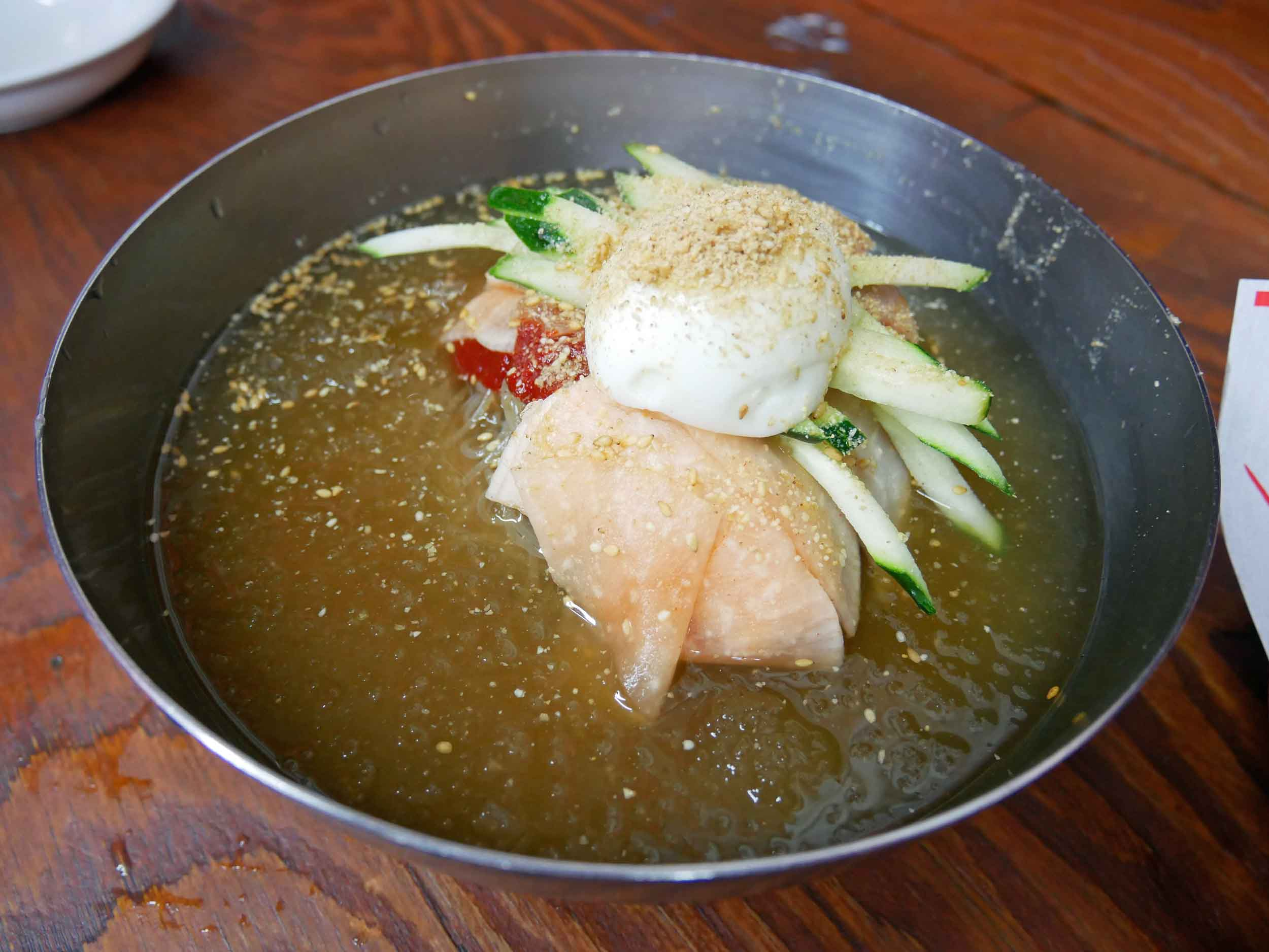 And Trey stuck to the more gluten-free option of  naengmyeon , or cold buckwheat noodles.