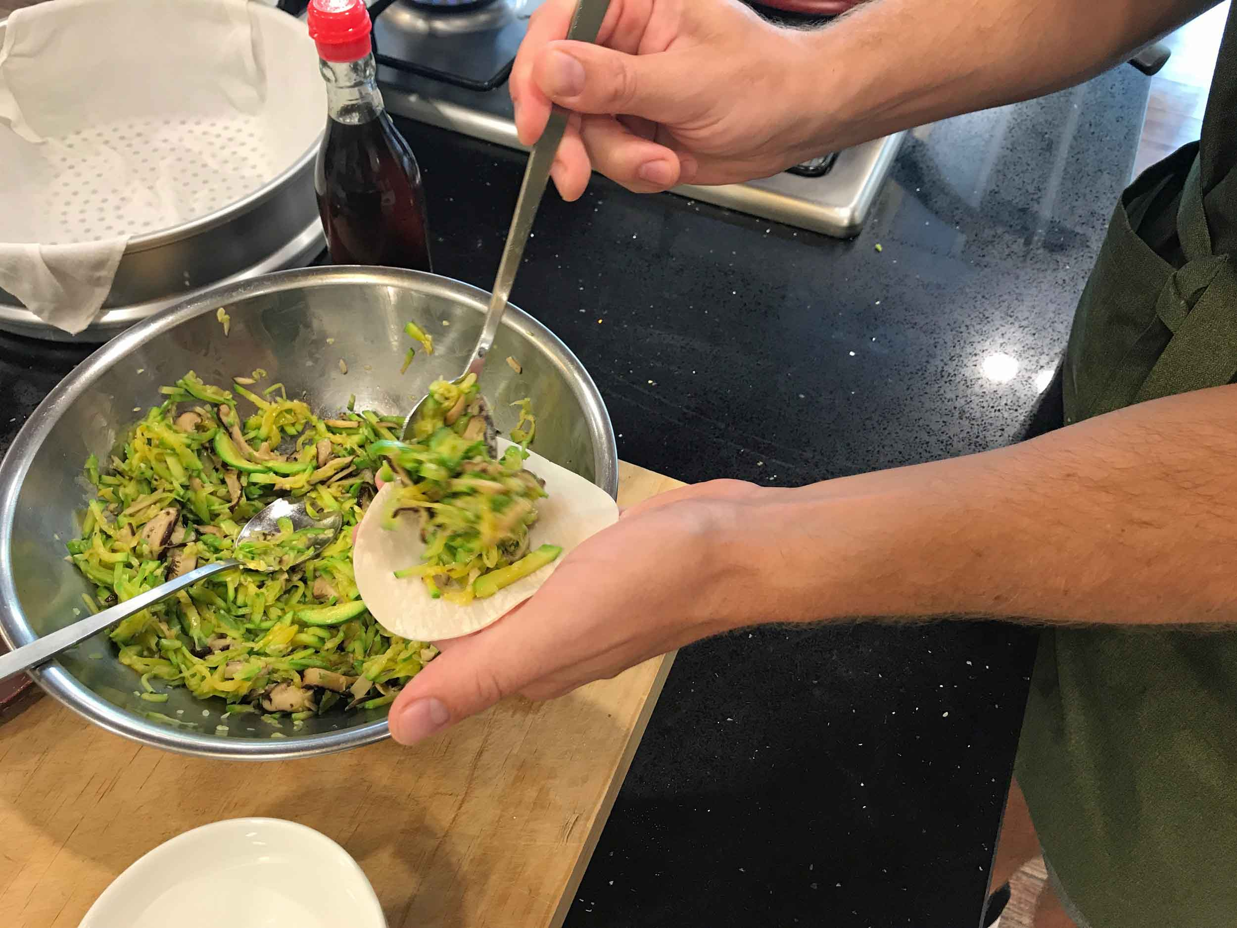 Stuffing our dumplings with a mixture of zuchinni and shitake mushroom.