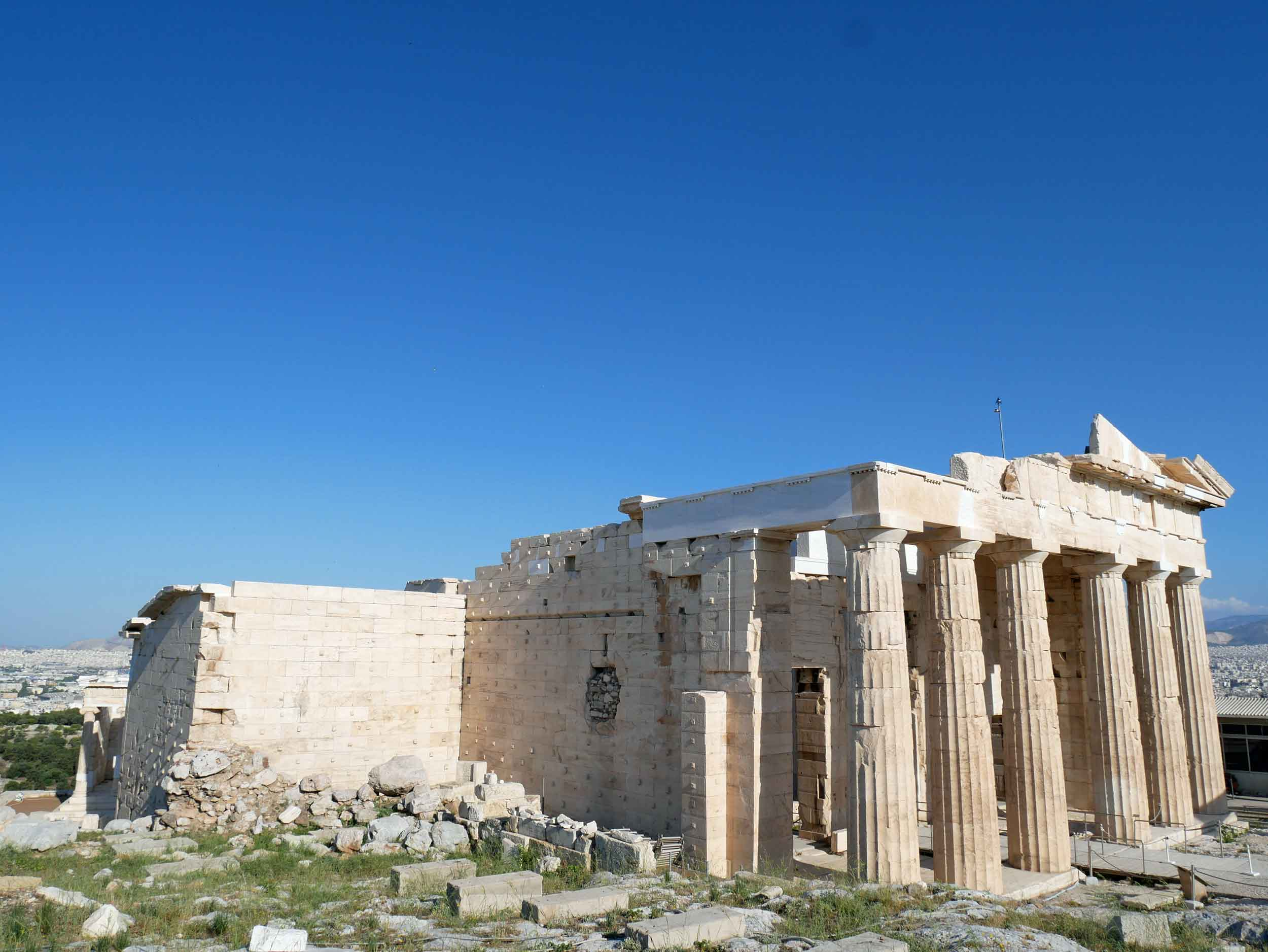 Erechtheum Temple is on the north side of the Acropolis and is dedicated to both Athena and Poseidon.