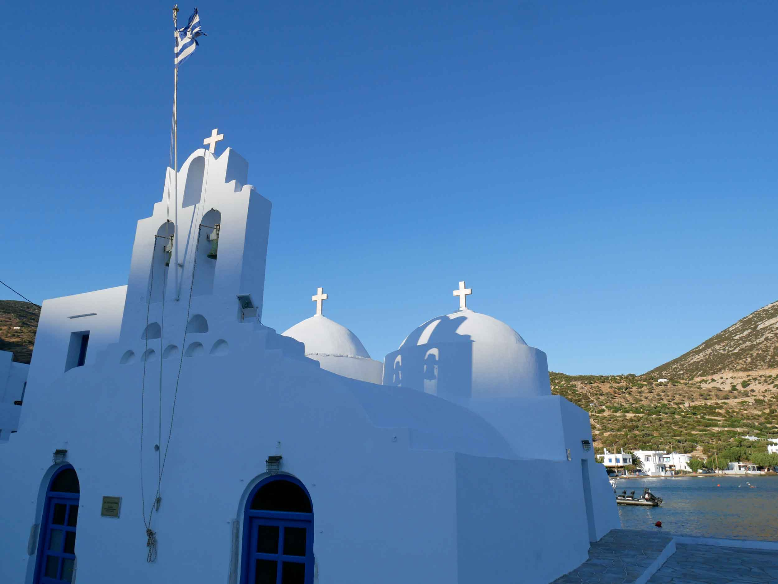 The beautiful church on Vathi bay catching the last rays of sunlight.