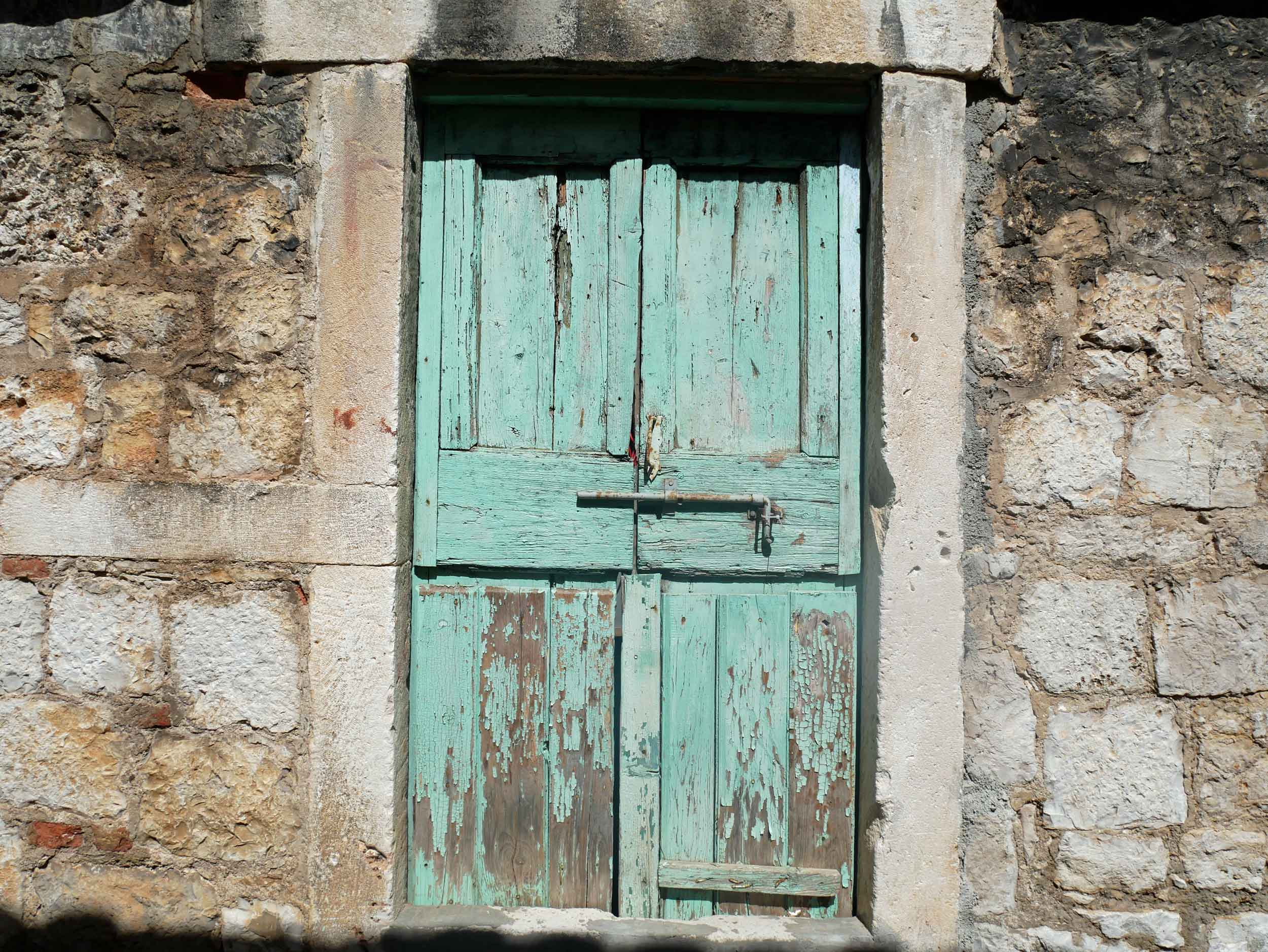 Doors and shutters throughout the village were painted a pale sea-foam green, which we adored.