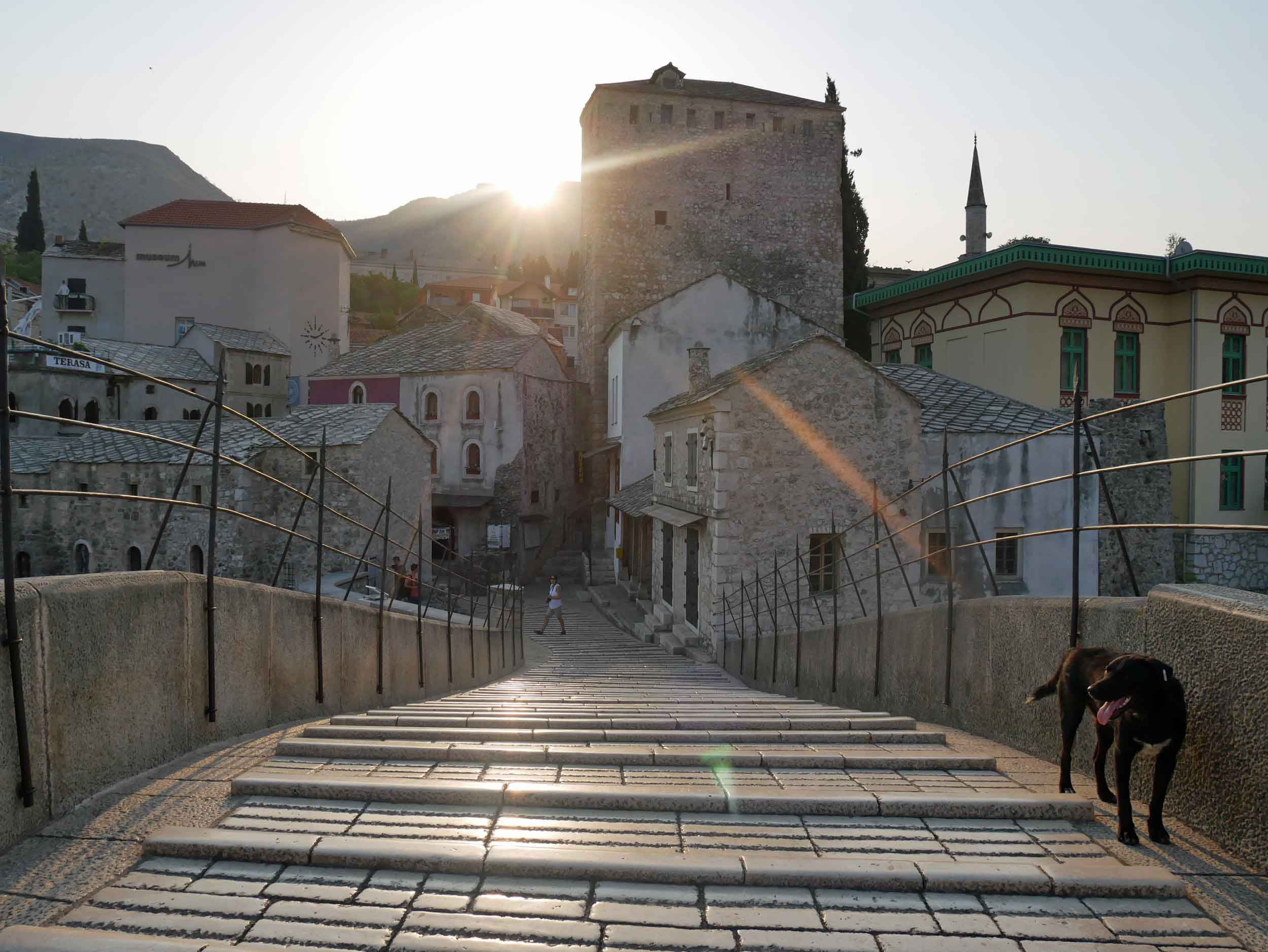 Walking the steeply curved Stari Most (Old Bridge), a medieval arched bridge from which the town Mostar gets it's name.