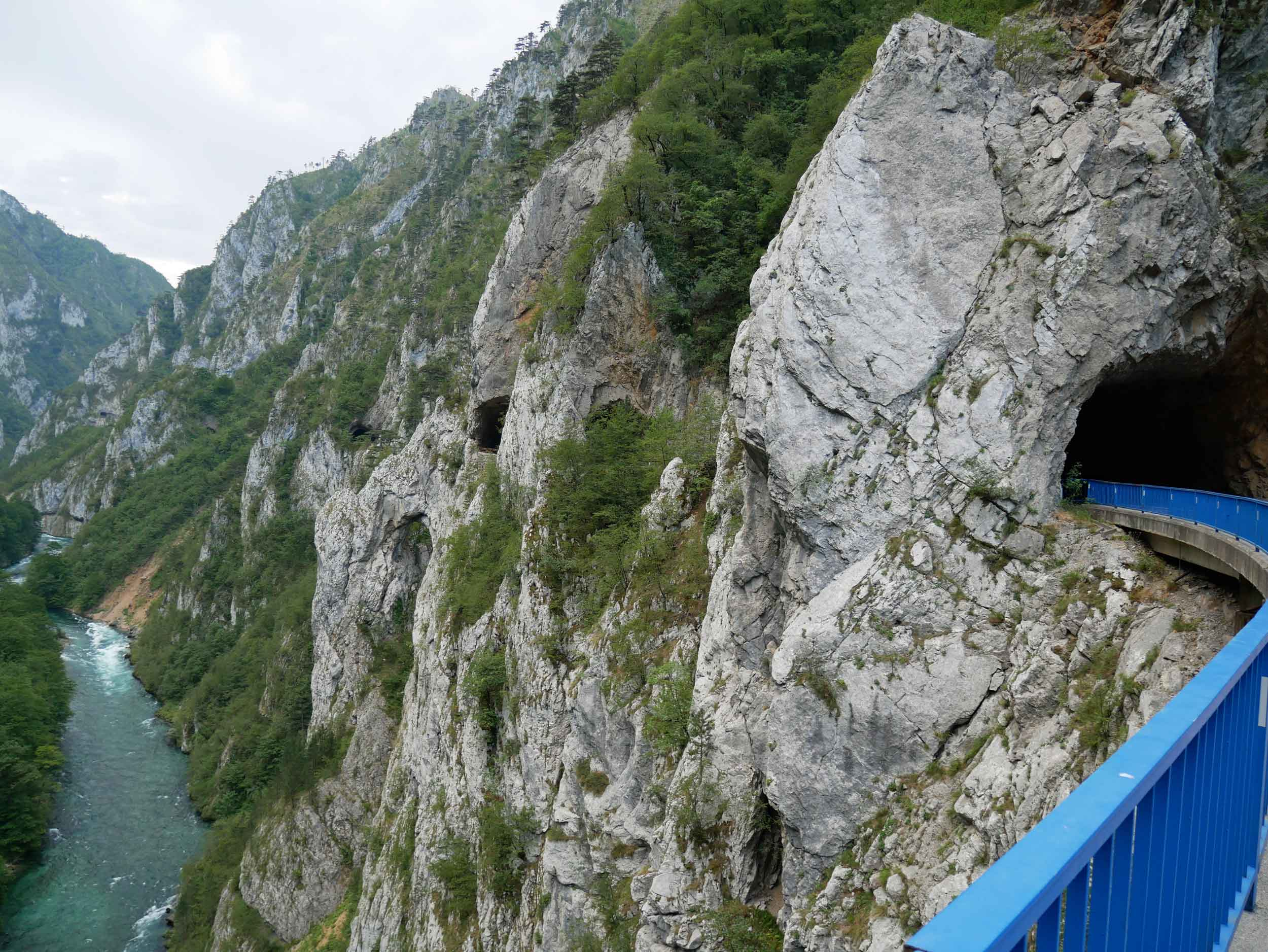 The twisting roads passed through numerous tunnels, rough and unfinished, carved from the mountainside.