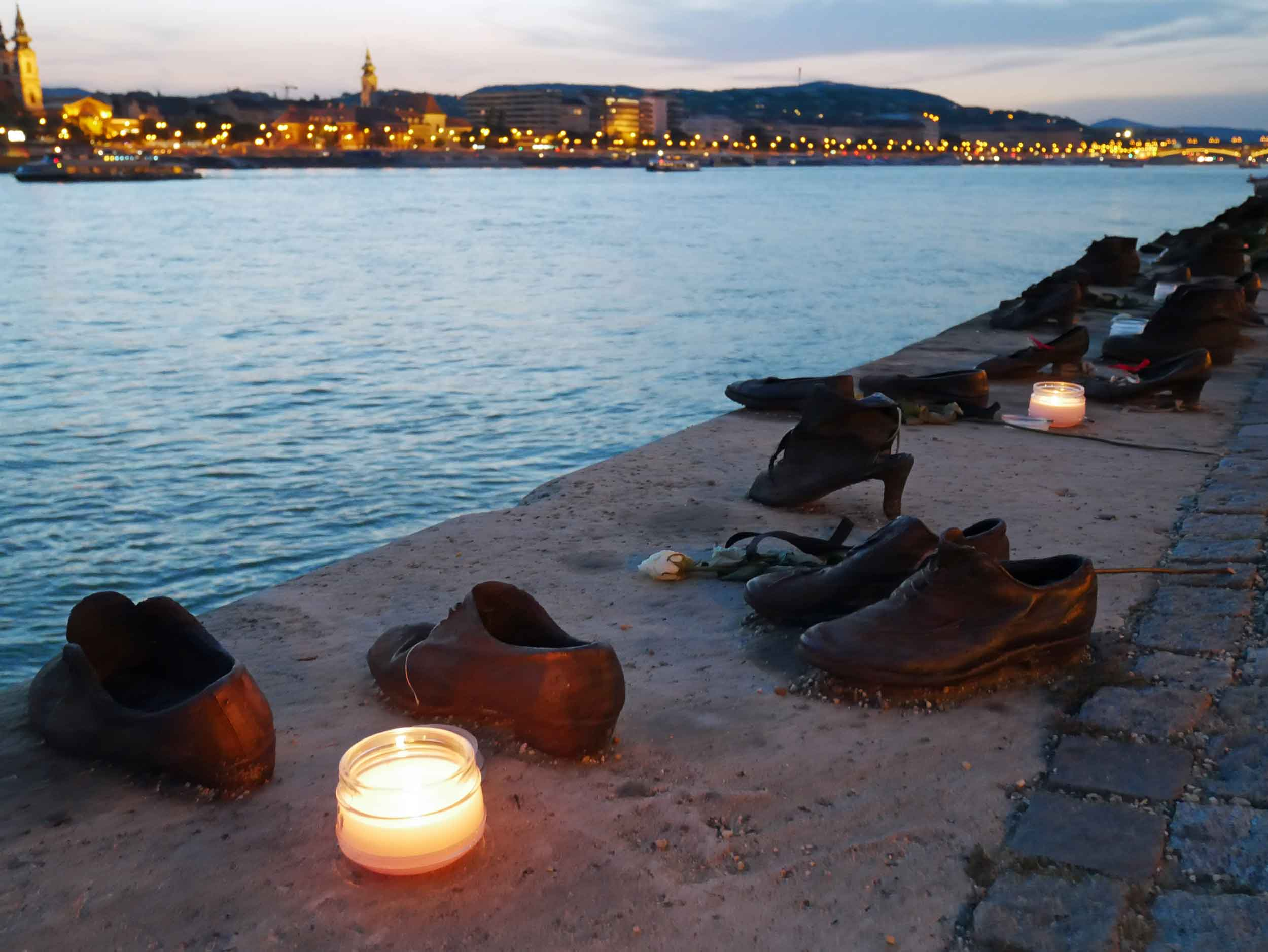 """Strolling the Danube, we passed """"Shoes on the Danube Bank,"""" a memorial to the horrific events of the mid-1940s when Jewish people were ordered to remove their shoes before being shot and falling into the river."""