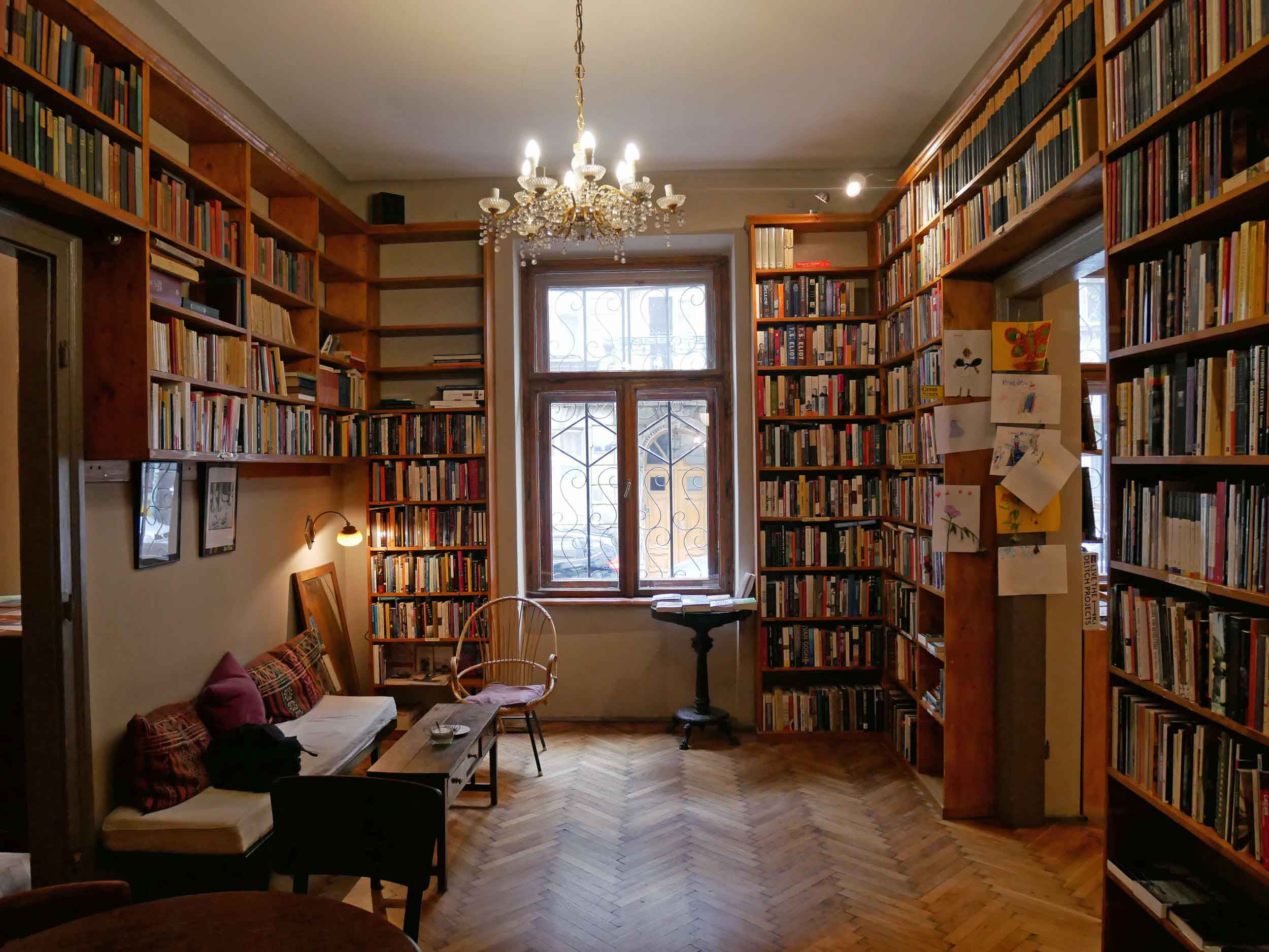Such a warm and inviting space, customers browse the shelves and read books or periodicals in the café or in the furnished back rooms of Massolit.