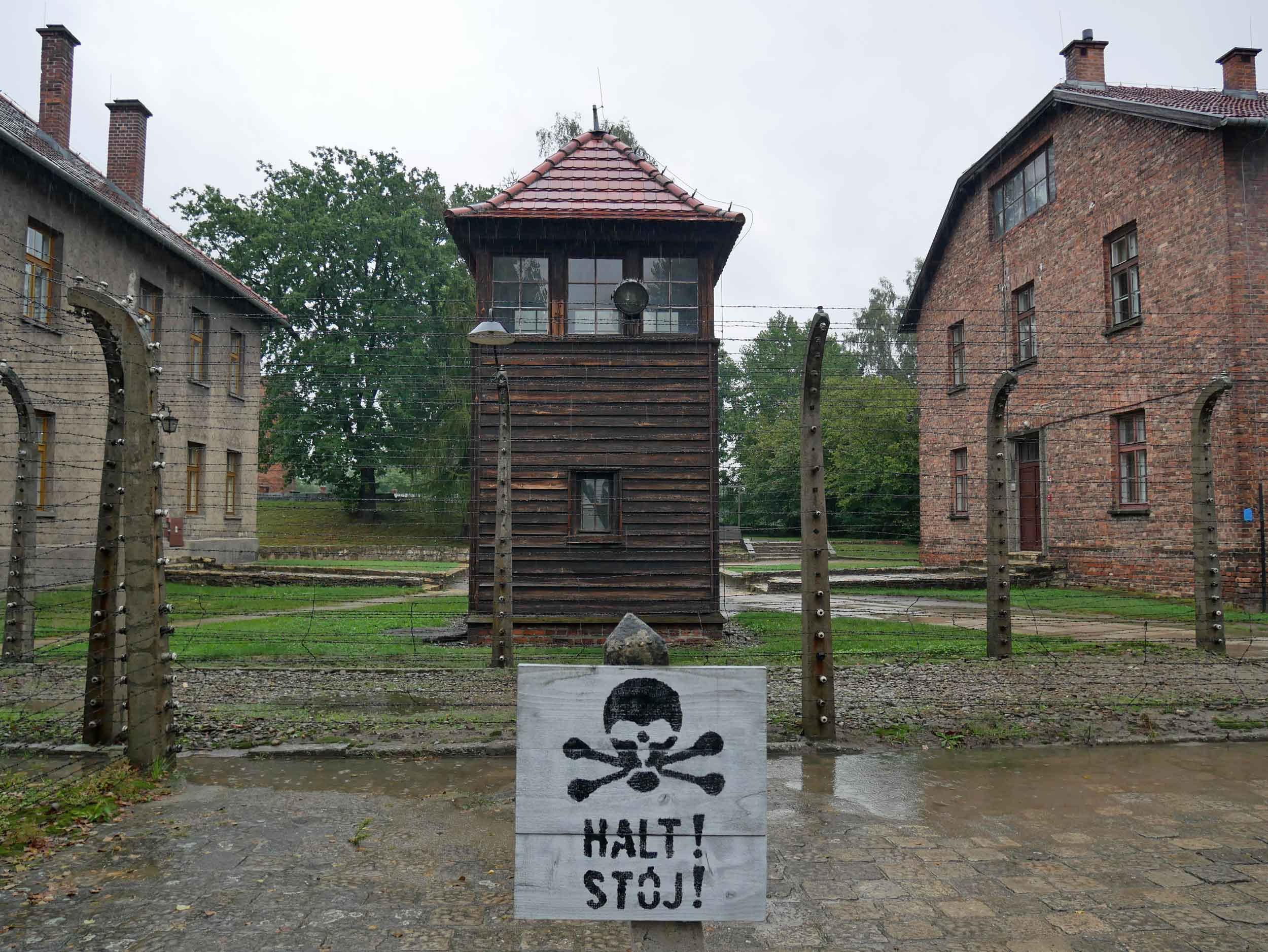 The camp's 16 brick buildings were guarded by towers, barbed wire and warning signs painted with skulls and crossbones, called  totenkopf  in German.