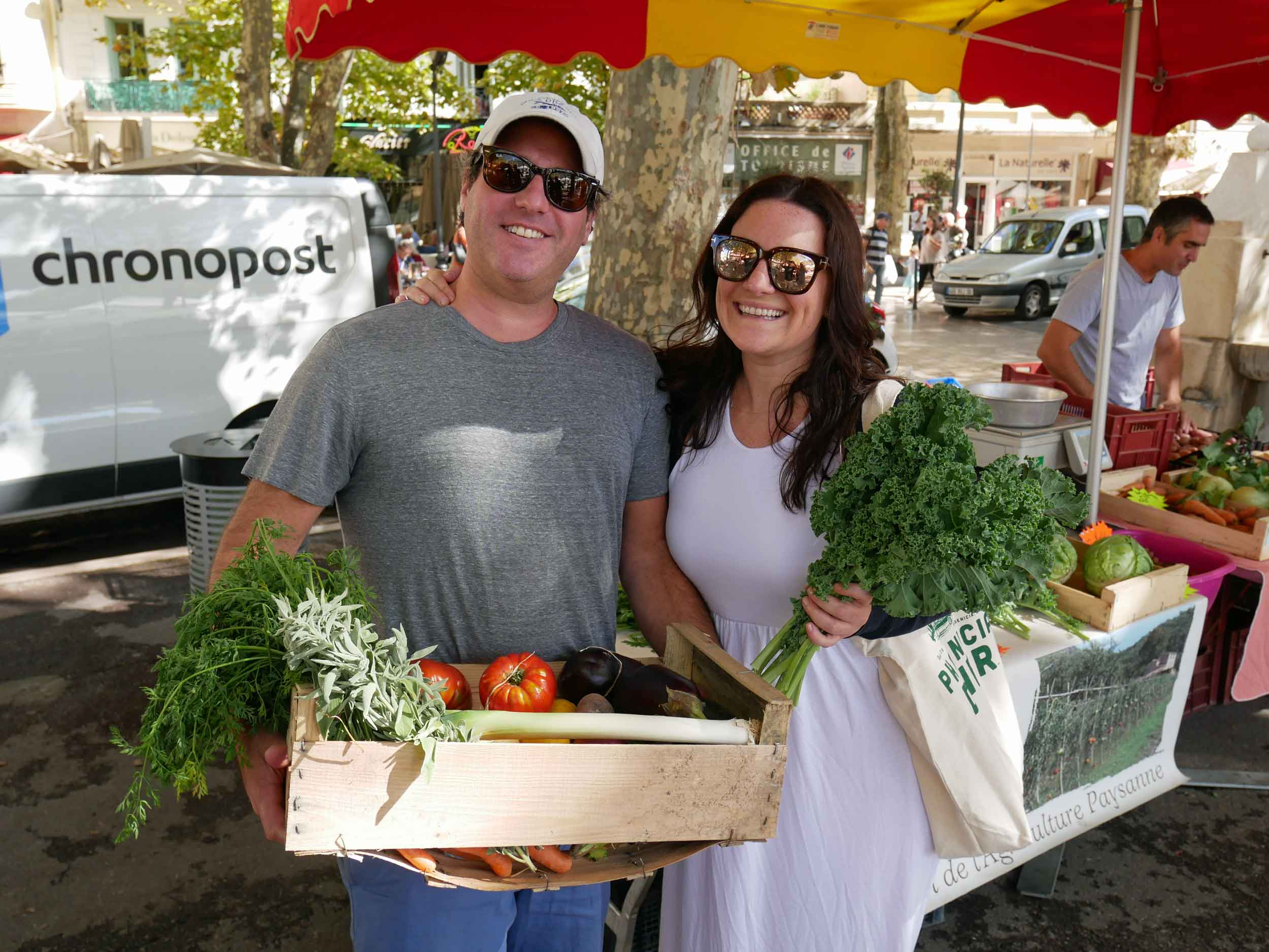 Our friends Leah and Mike buying provisions at Vence's farmers' market for our evening's feast.