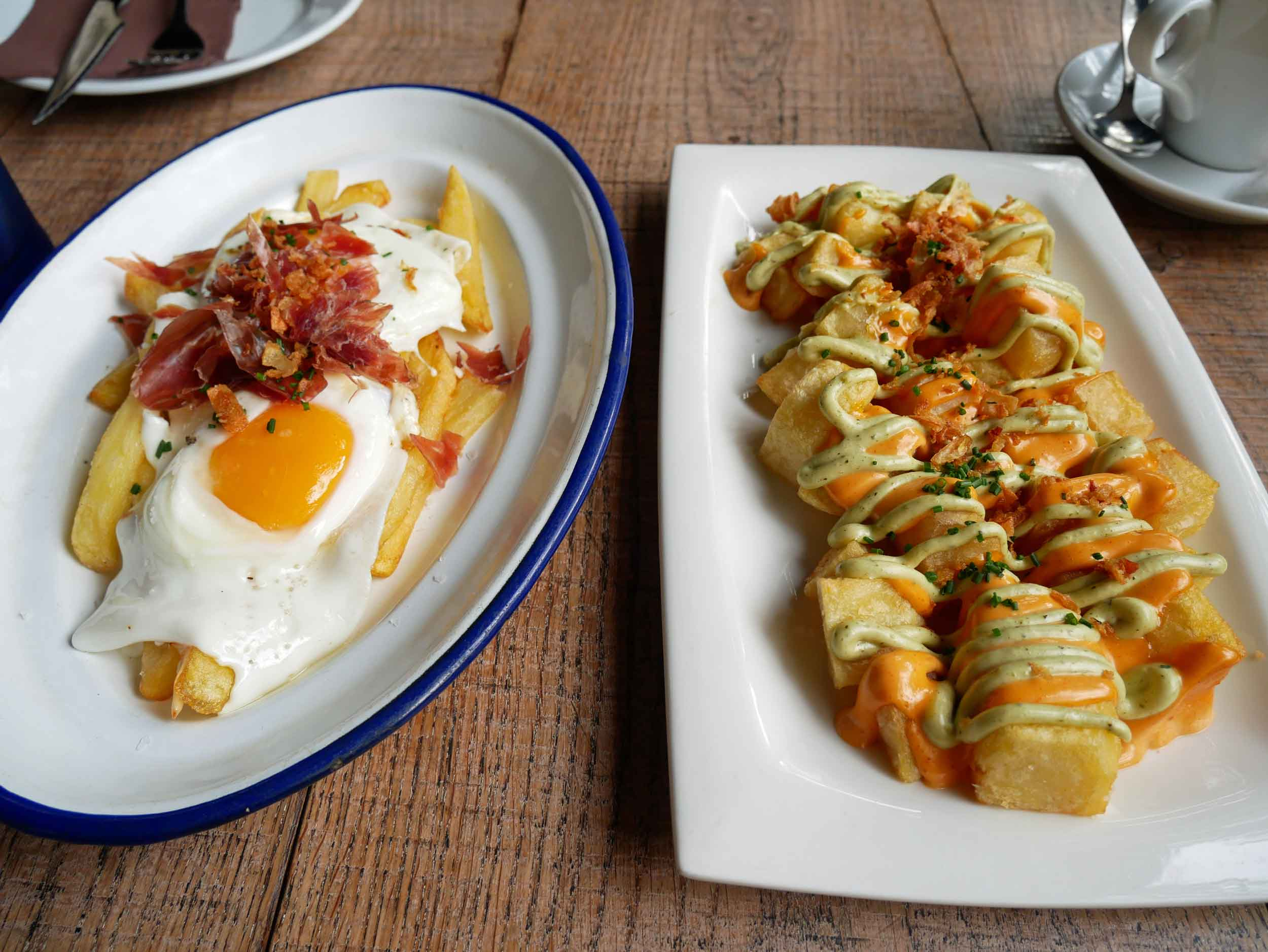 First thing we did when we arrived in Barcelona was head for  patatas bravas  and  fried egg with jam  ón  at Bodega Granados (Sept 18).