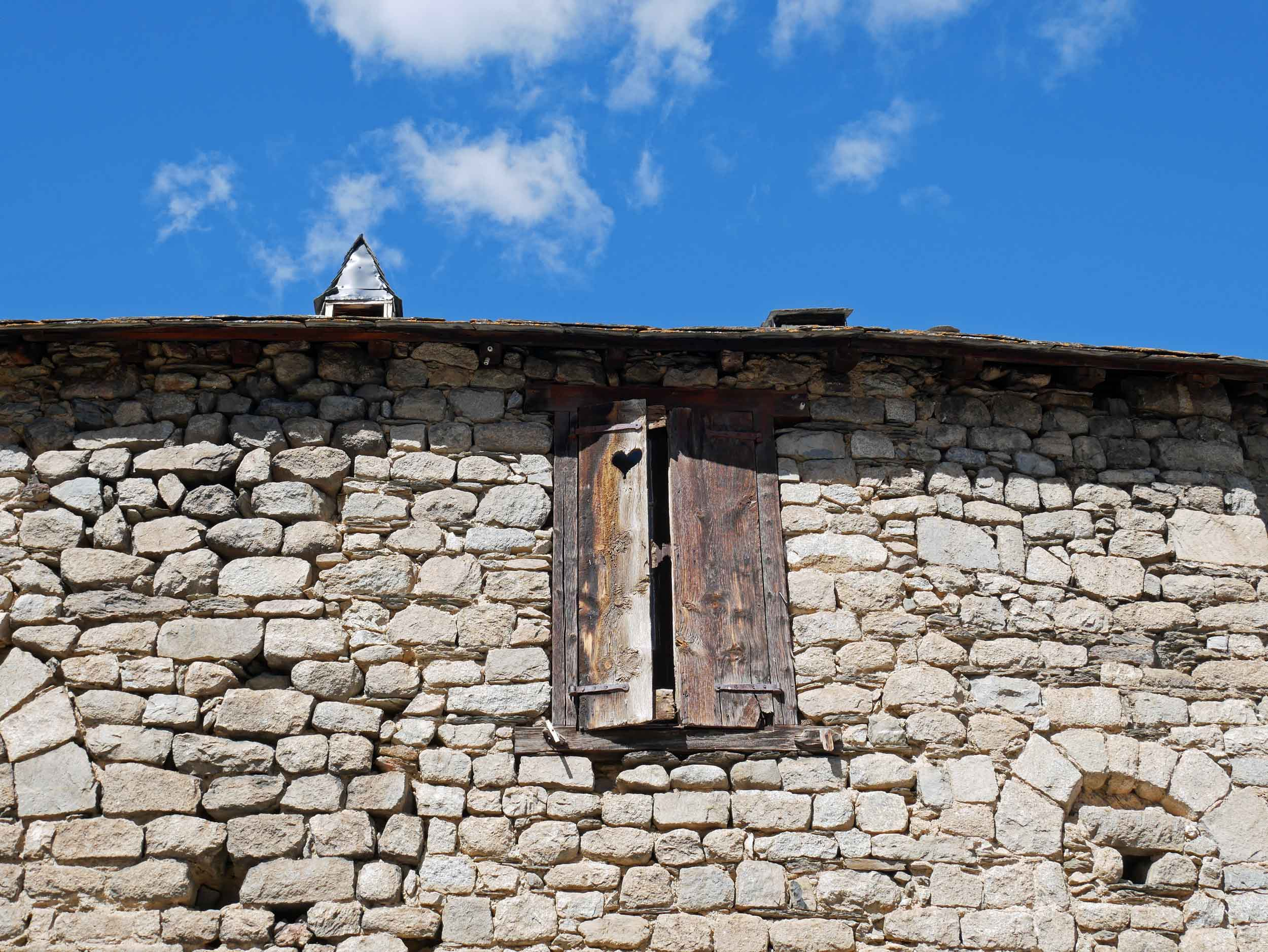 This heart-shaped window shutter in the tiny mountain village of Son caught our eye.