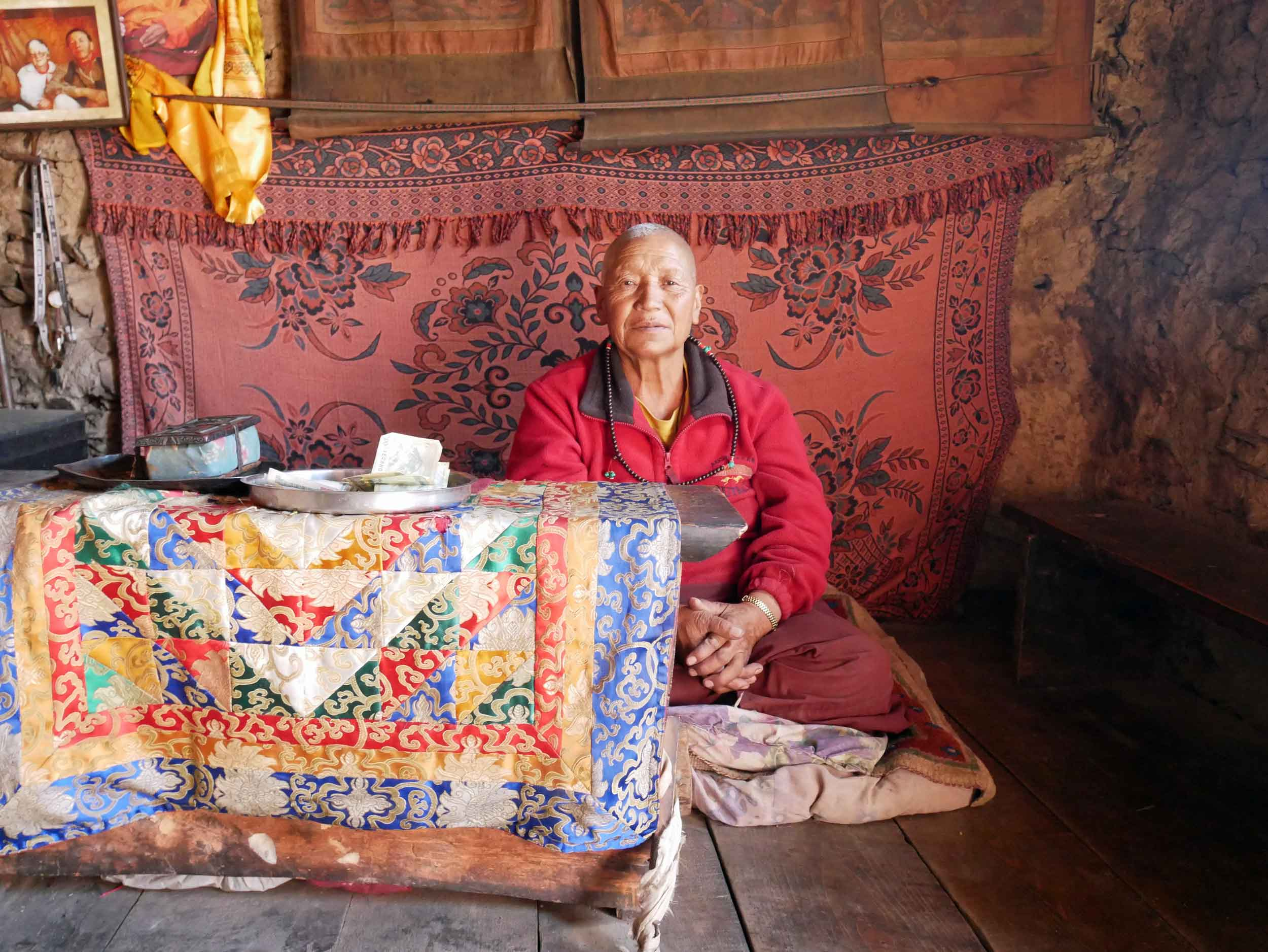 The  100 Rupee Monk , a holy hermitic Buddhist nun who offered us blessings for safe passage over the Pass.