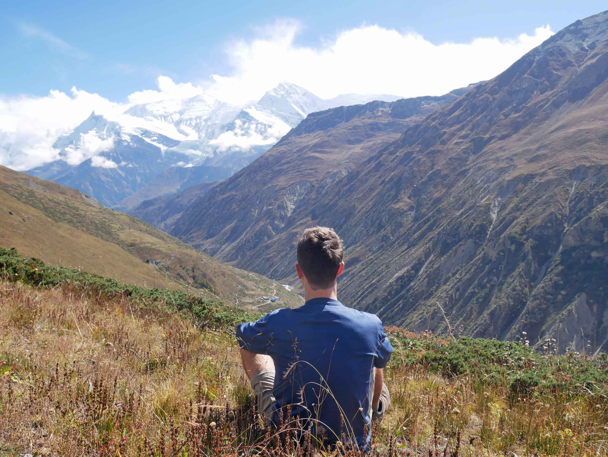 Martin taking a moment to appreciate the beauty of the range above Yak Kharka -and a hike without the pack!