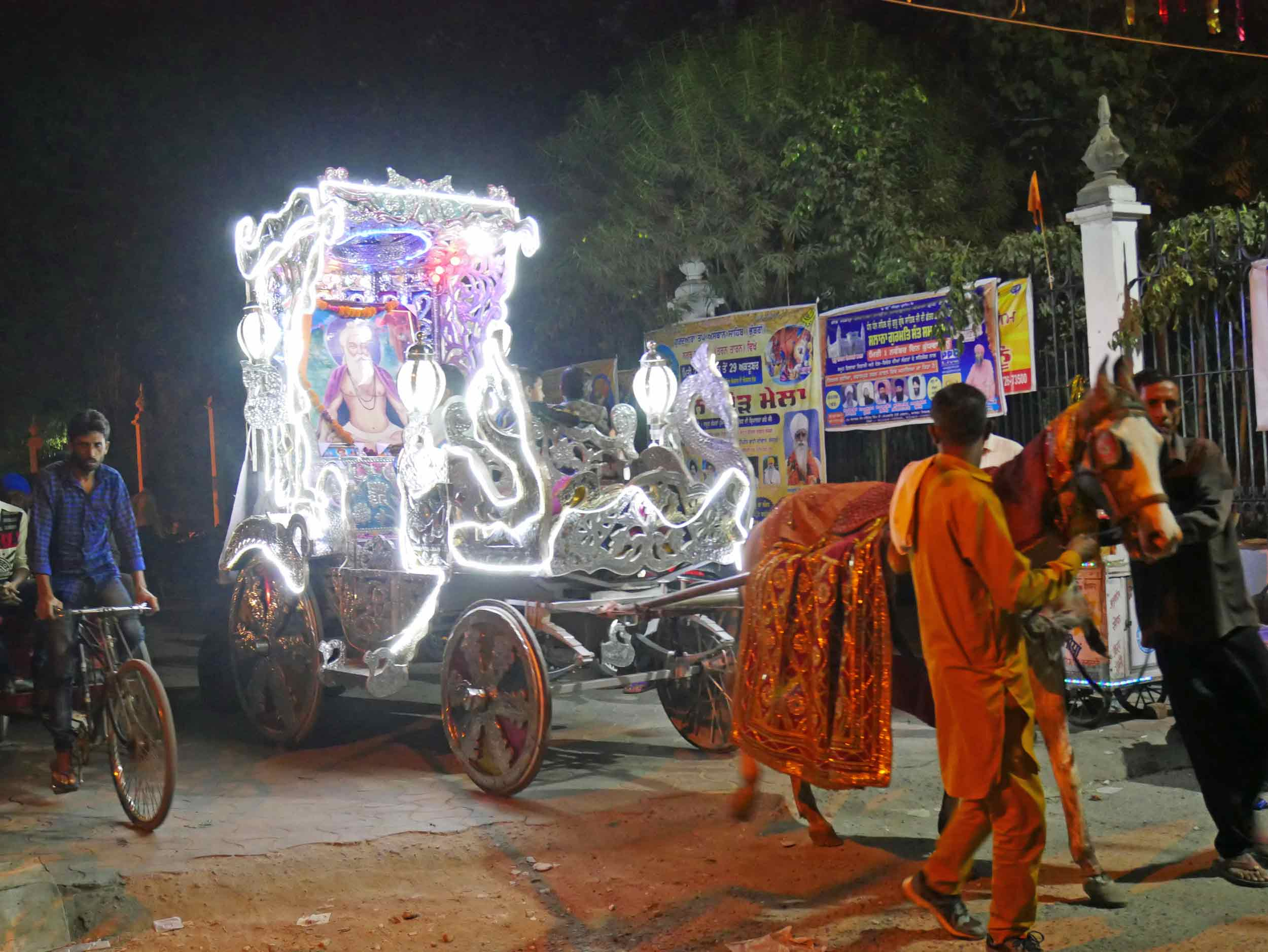 Our first evening in Amritsar, we stumbled upon a flashy, technicolor parade honoring the holy (Oct 30).