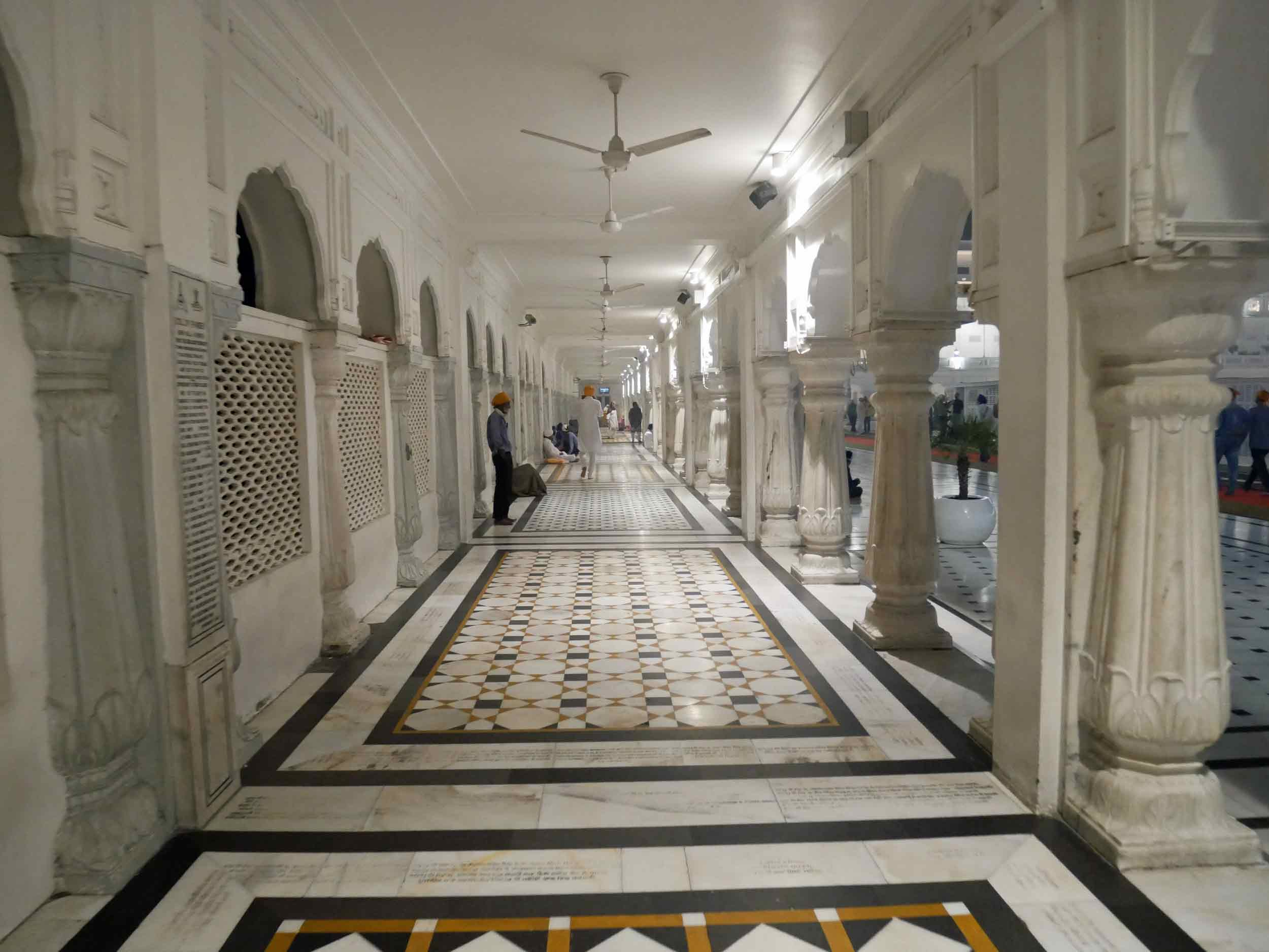 It is customary to walk the porticos that surround the Golden Temple in a meditative prayer.