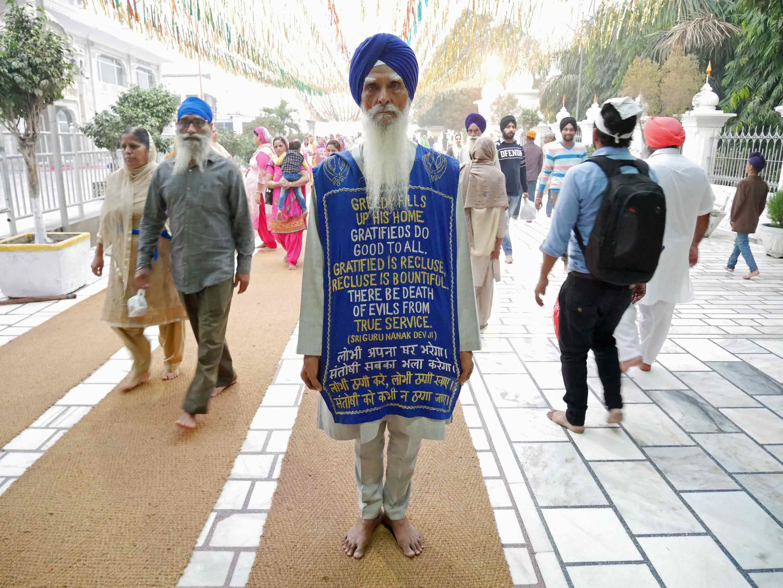 In the comings and goings of thousands of pilgrims, this man requested we take a photo of his message.