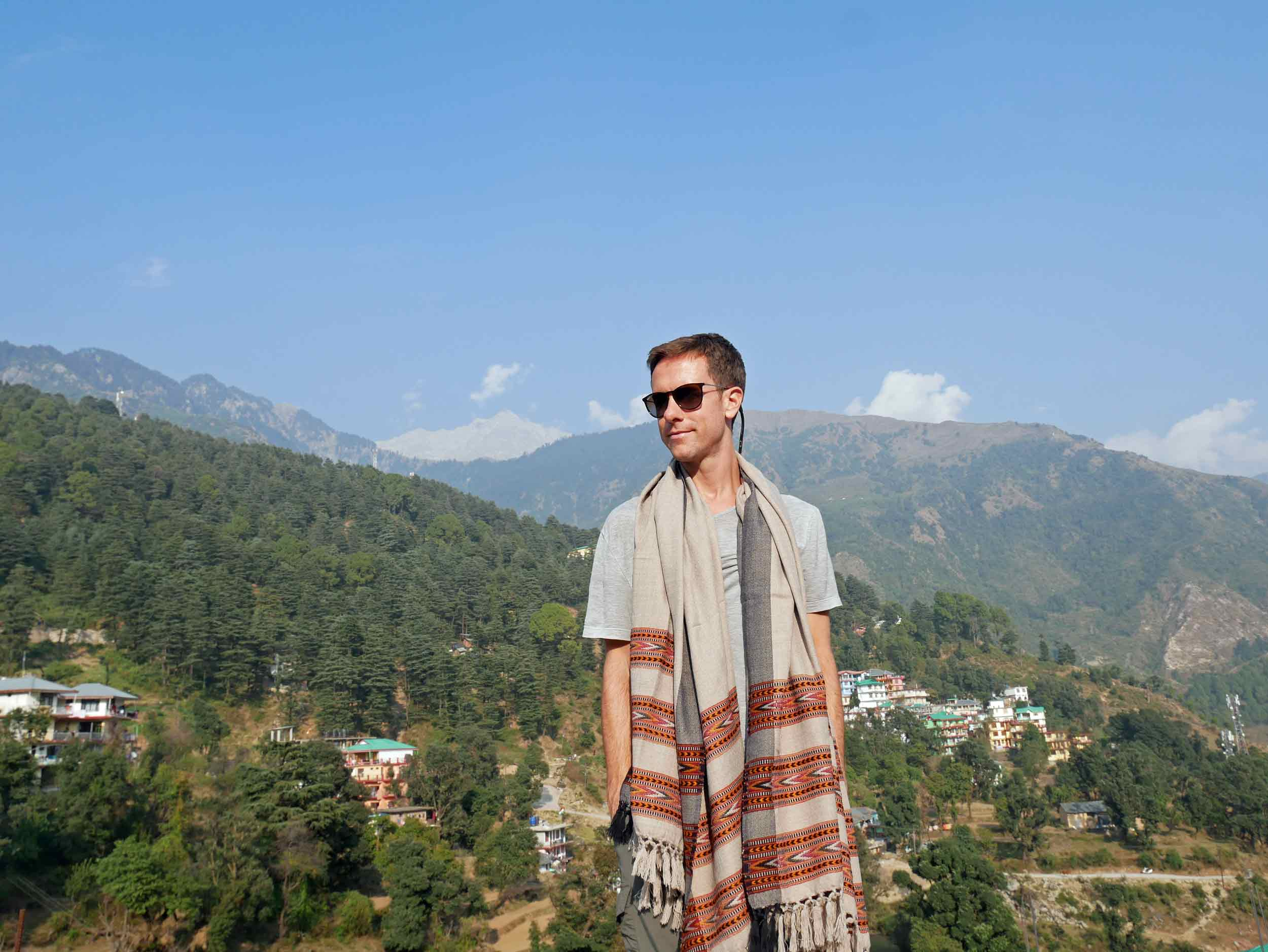 Martin wearing a Tibetan shawl and taking in the sunshine on our roof deck, overlooking the Buddhist village in the Himalayas.