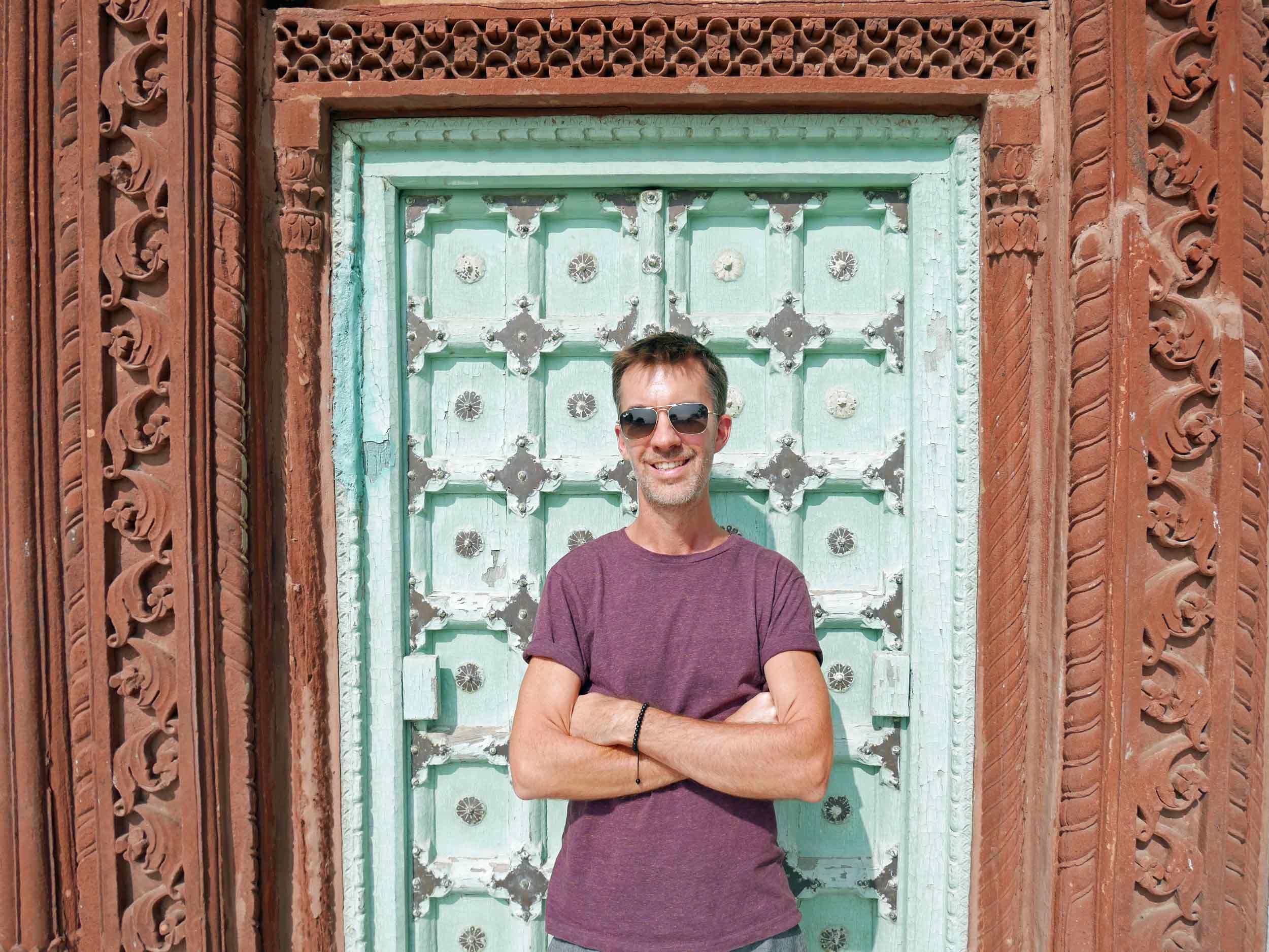 """Trey striking a pose at one of the few colorful spots within Jaswant Thada, the """"white temple."""""""