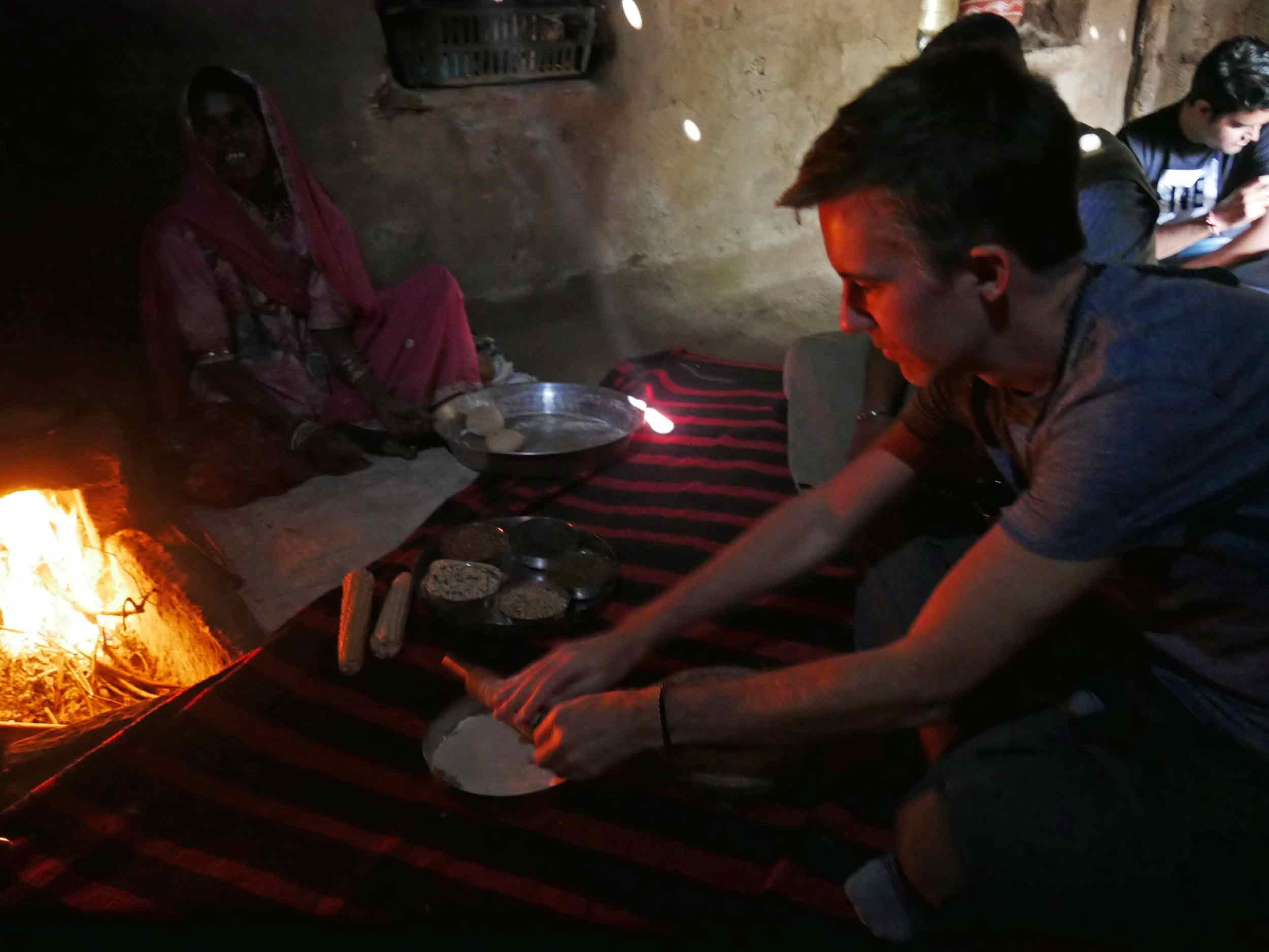 Trey taking a turn rolling  chapati .