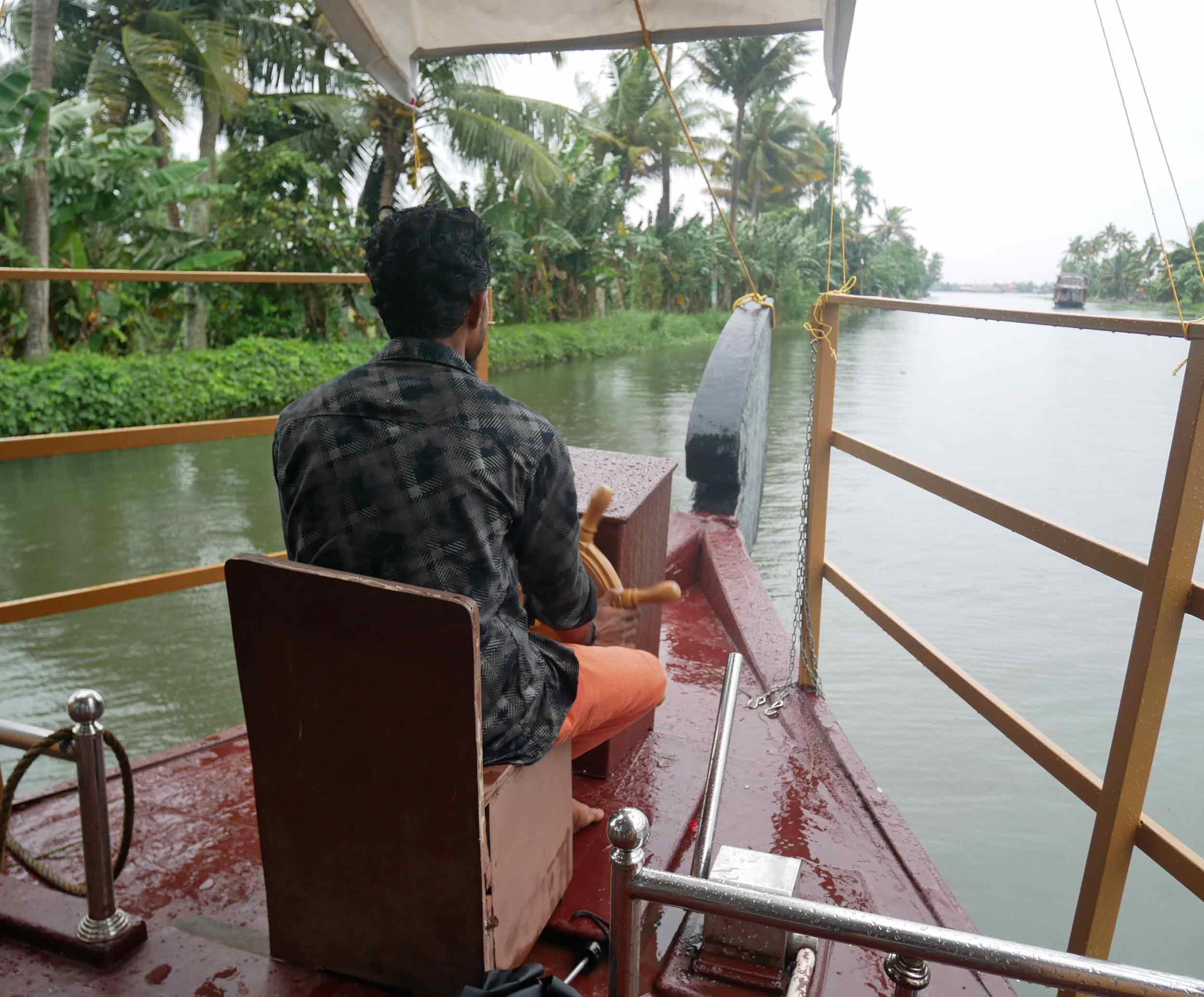 Our fearless boat captain, braving the rain brought by a cyclone out in the Arabrian Sea.