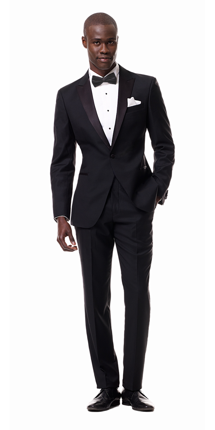 Black Custom Tuxedo with Peak Lapel  The gold standard in formalwear, a black tuxedo with peak lapels is as classic as they come...They're great for weddings but don't keep this one locked away as solely a wedding tux. - © Black Lapel