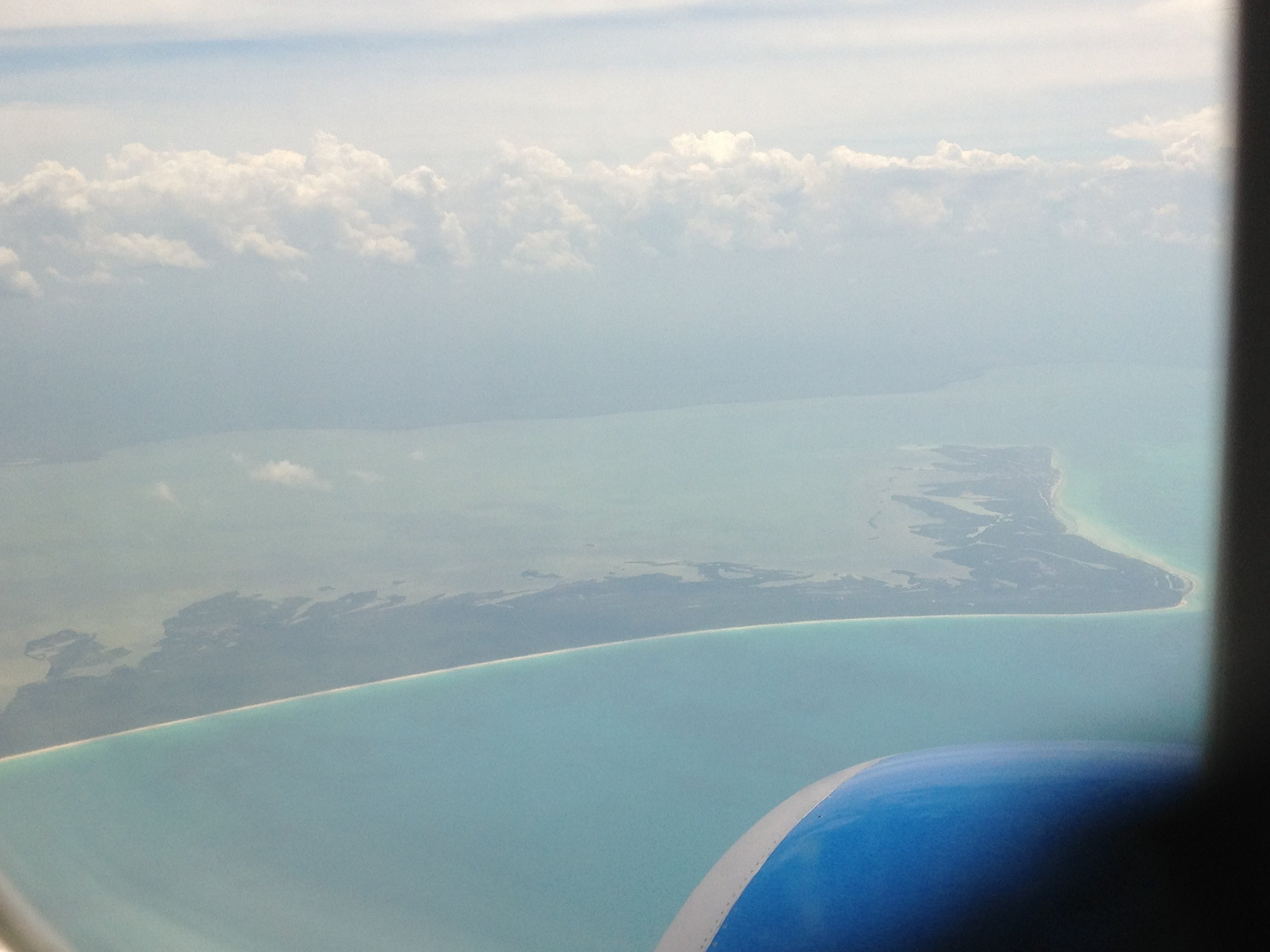The view from the plane landing at Cancun International Airport...in less than 123 days we'll be right back here!