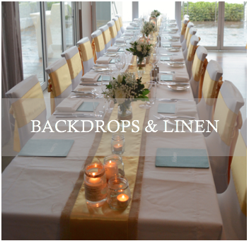 curtain backdrops, table runners and chair sashes