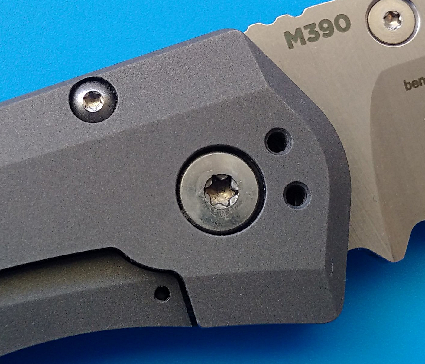 Male pivot screw is slightly off centre.