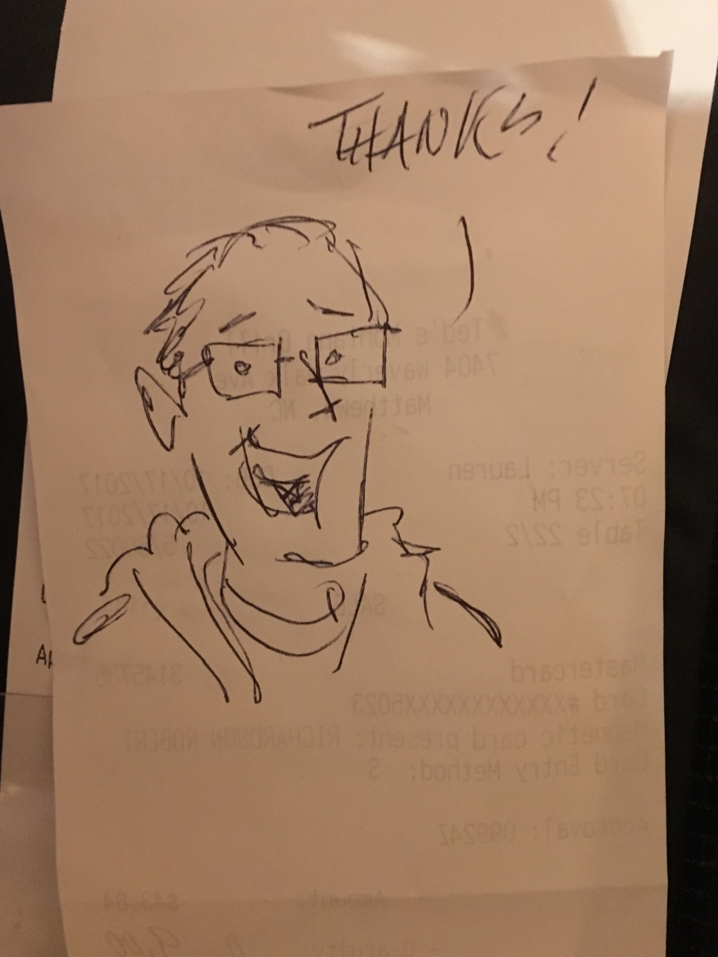 A guy drew this self portrait on the back of the receipt for me.
