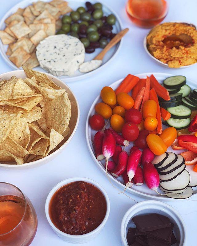 This is how we do ladies night! 🤗🌻 Orange wine, chocolate, chips + salsa, homemade hummus + all the veg, @miyokos_kitchen vegan cheese, @simplemills crackers, olives. YUM Happy Saturday, loves!
