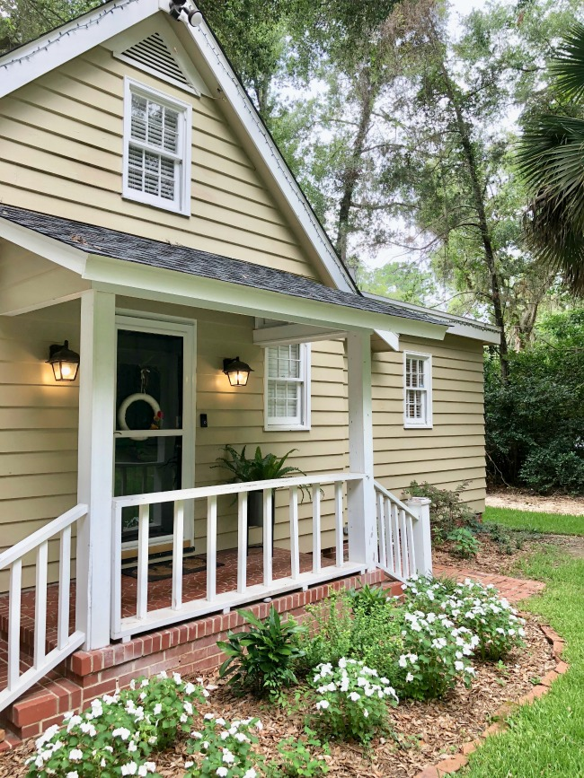 Jules and Louis Blog - A cute adorable home in Tallahassee - the front of the house with porch and stairs.jpg