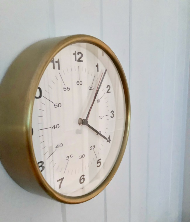 Jules and Louis Blog - A cute adorable home in Tallahassee - detail of clock on wall.jpg