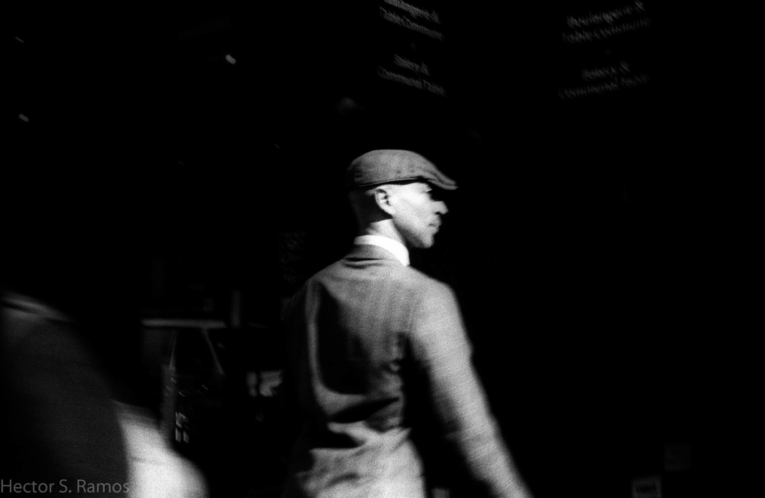 My favorite among the lot.  I glanced over my left shoulder, saw this image, instinctively lifted my camera (which was without any battery), and without any time to focus nor think of the exposure, pressed the shutter release button.  The image was gone in a second. He stepped into the sunlight passing through in between tall Manhattan buildings and into the dark shadows. I got lucky.