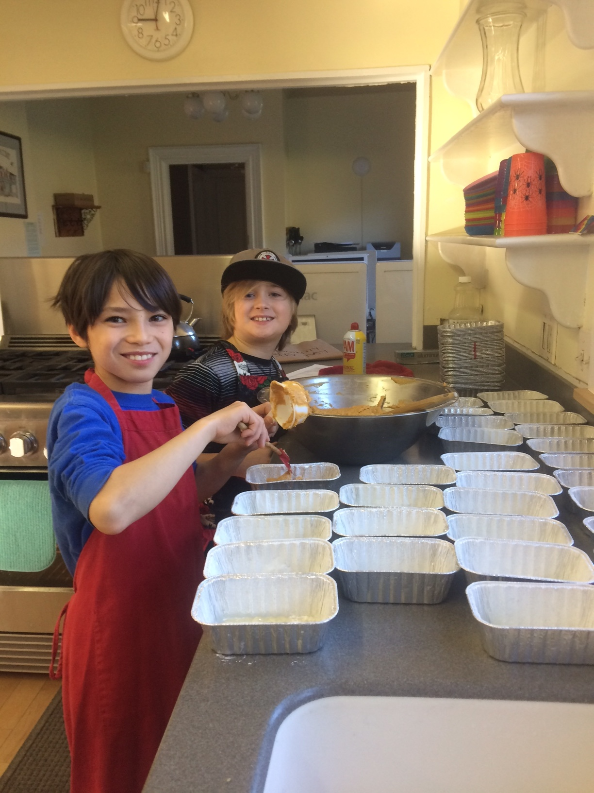 Metellus Harris and Koji Ebbett help prepare 48 loaves of pumpkin bread that were donated to the Lyndon Area Food Shelf as part of The Riverside School Community Service Day.