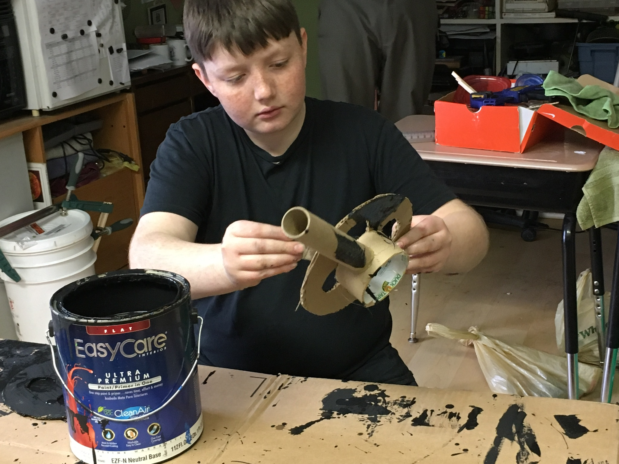 6th grader Oak Clarke of East Haven works in the Props elective to craft an old fashioned movie camera and film reel for Riverside's production of Singin' in the Rain.  Performances are Friday and Saturday, March 24 and 25 at 7:00 pm in the Barn at Riverside.  The show will last about 90 minutes, including an intermission and bake sale, and is appropriate for all audiences. Admission is by donation.