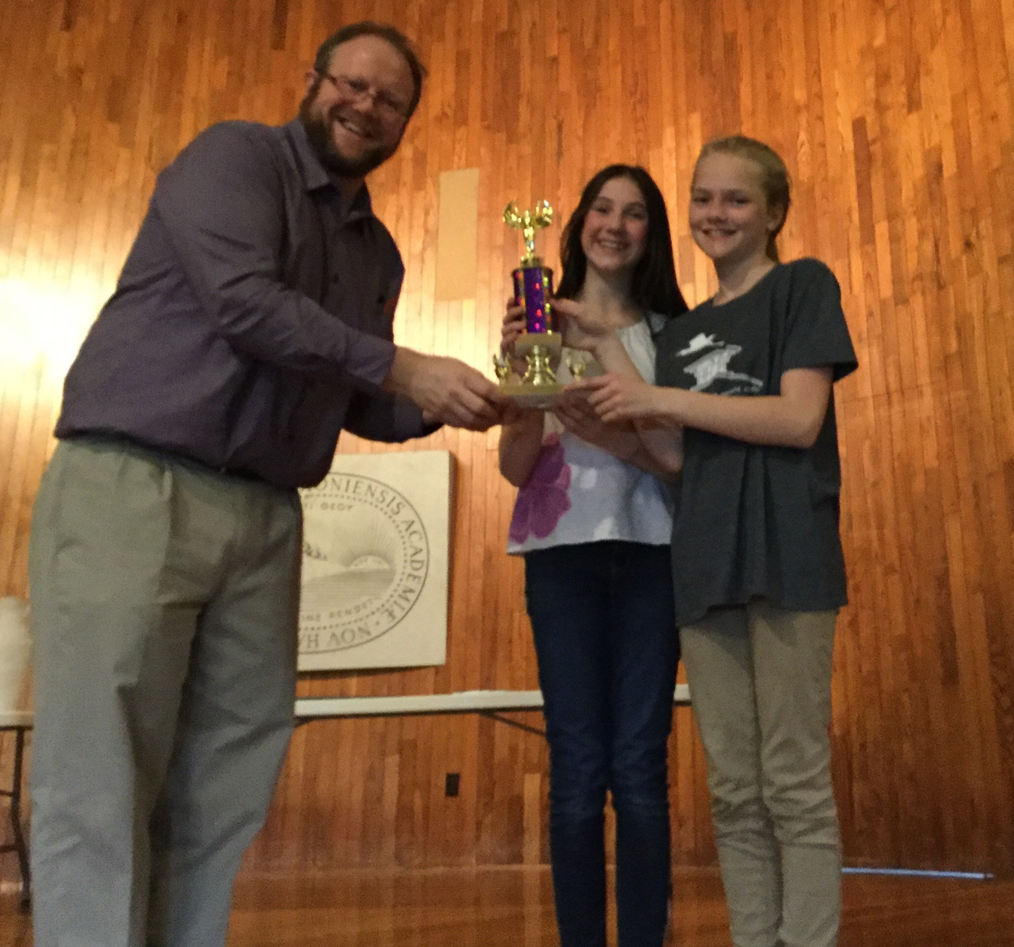 Katie Lyon from Waterford and Phoebe Barrett from Westmore receive a trophy for their win in the novice Certamen competition.